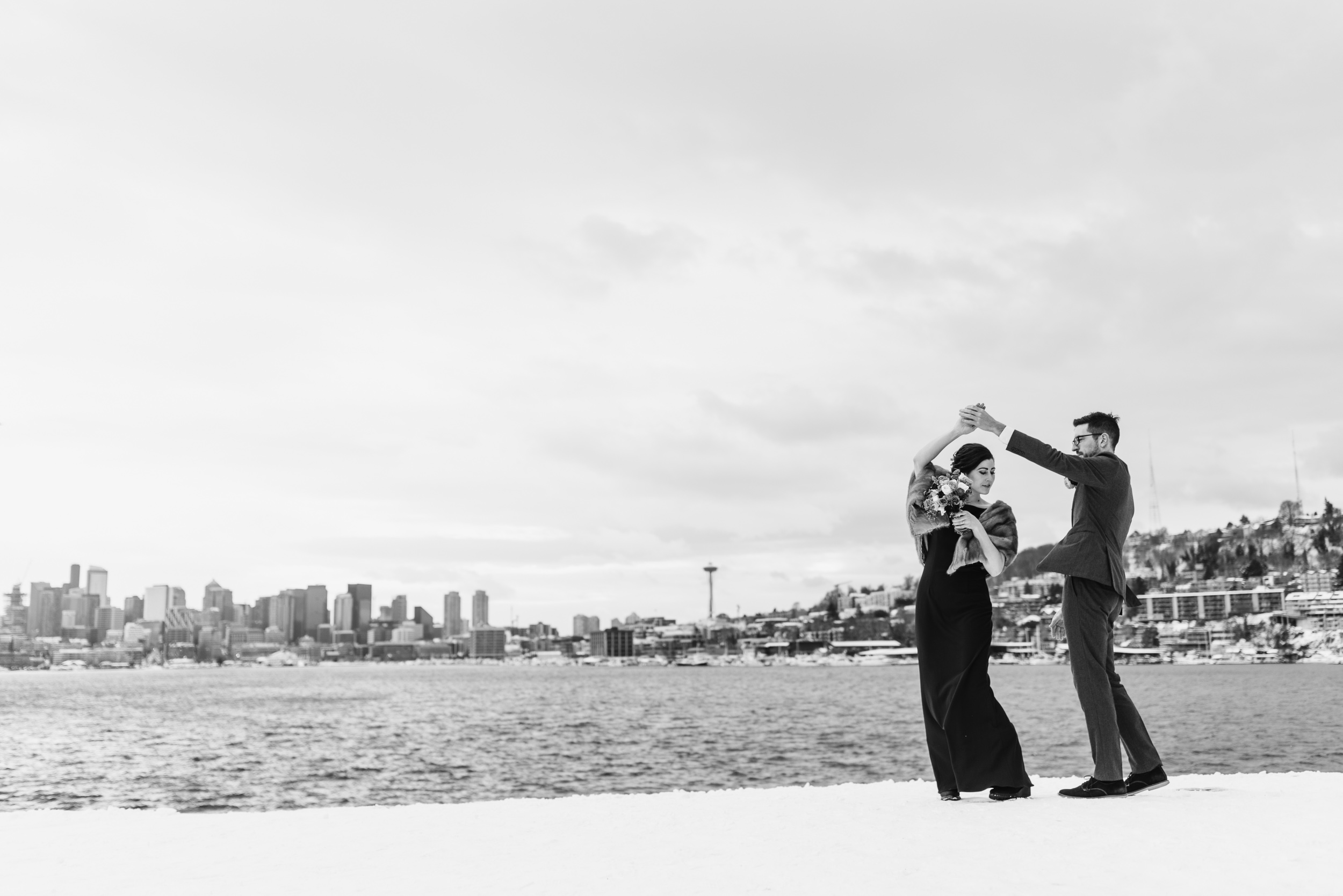 Bride and Groom dance in snow
