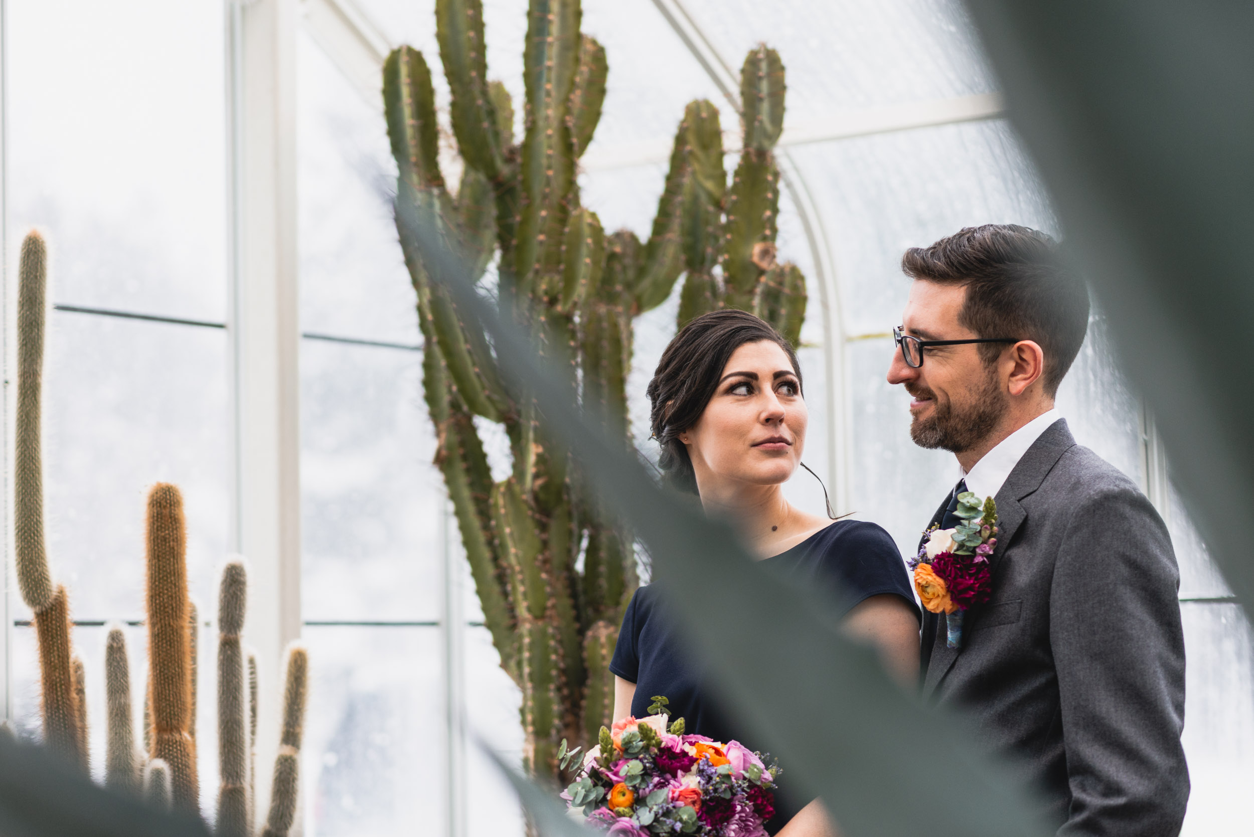 Bride and groom among plants