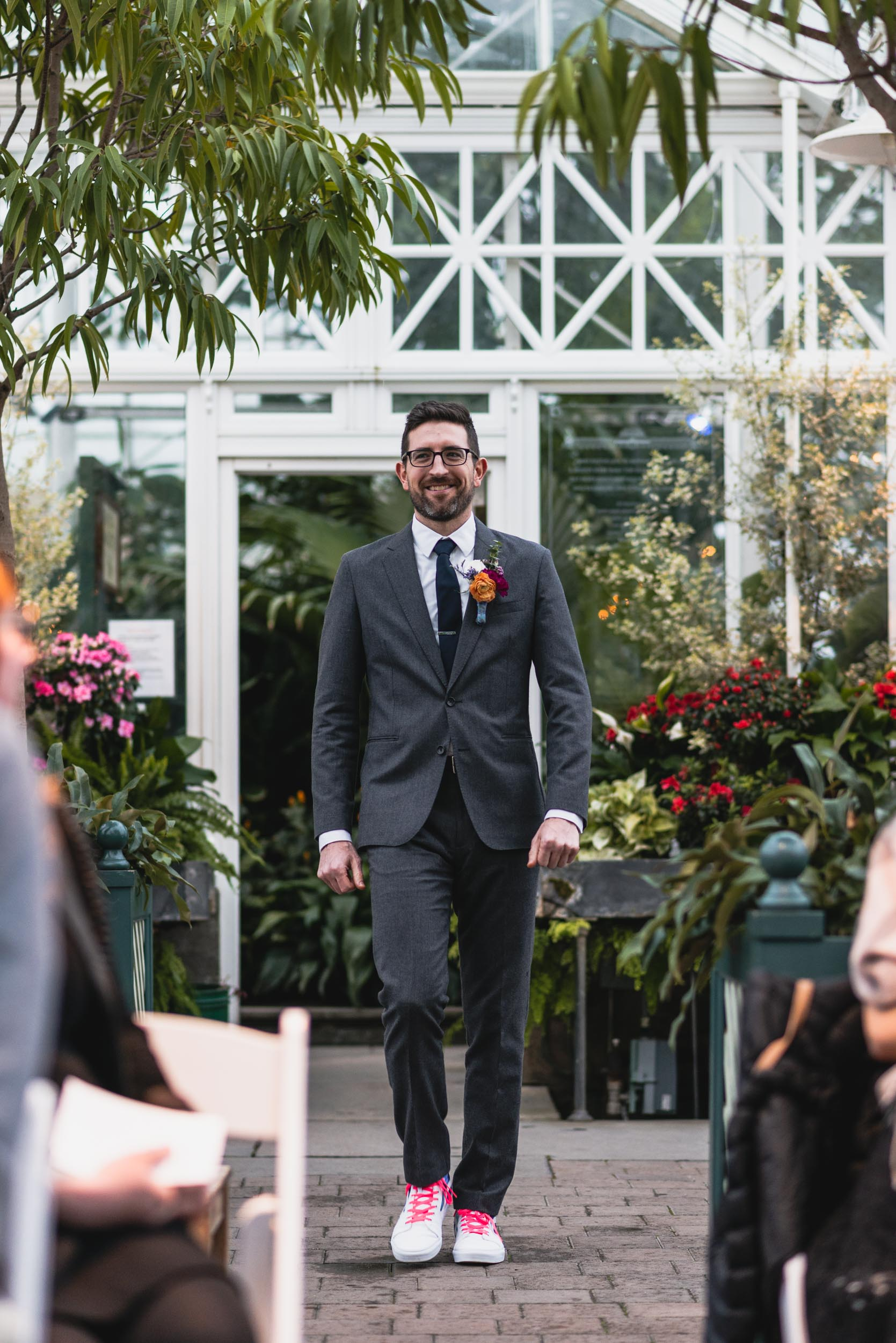 Groom walks down aisle