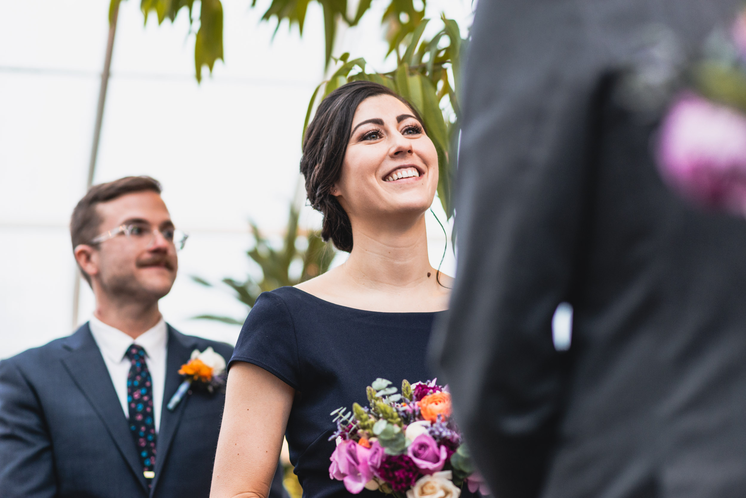 Bride smiles at Groom in conservatory