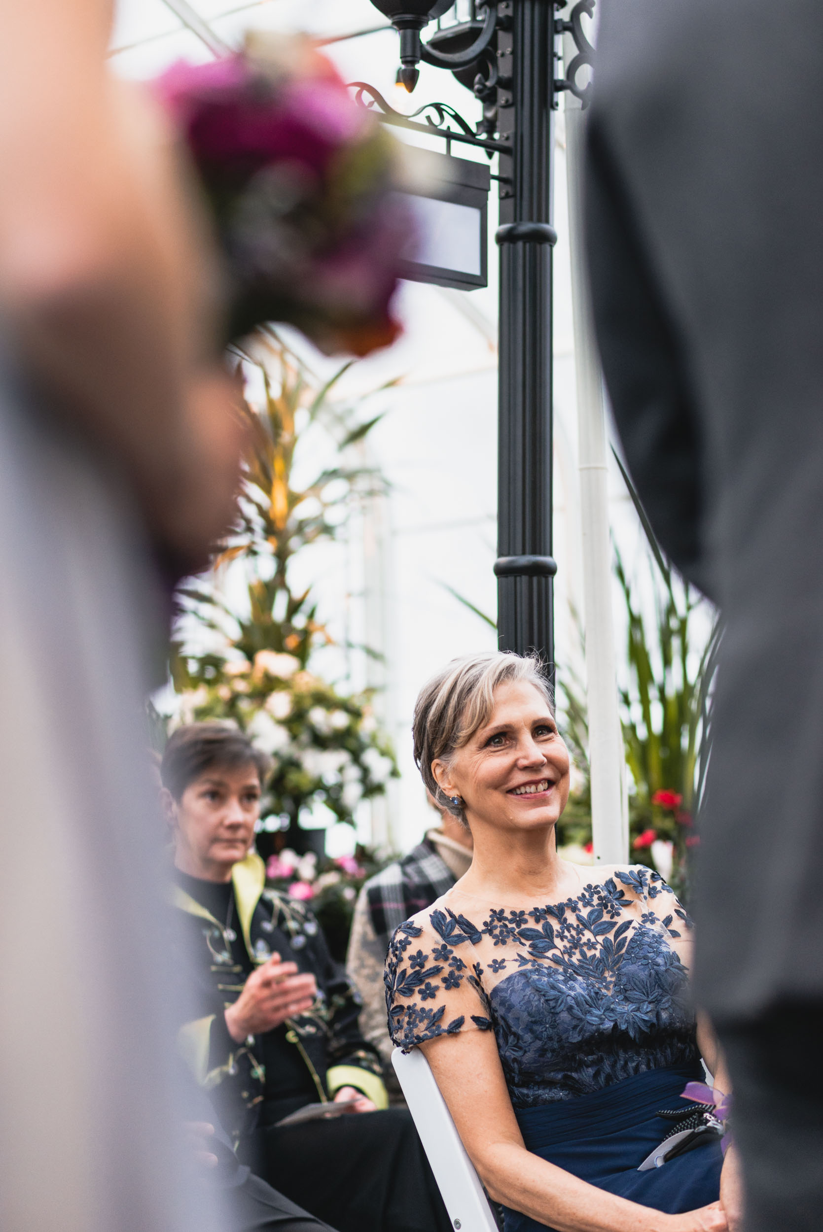 Mother of the Bride smiles during ceremony