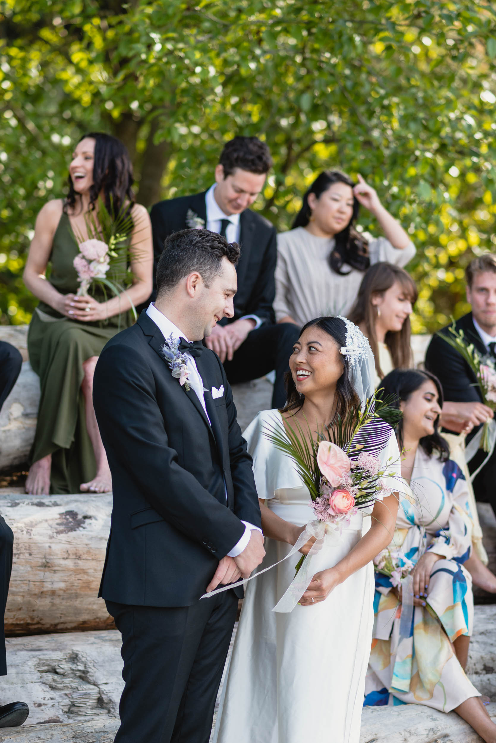 Bridal party at beach with logs
