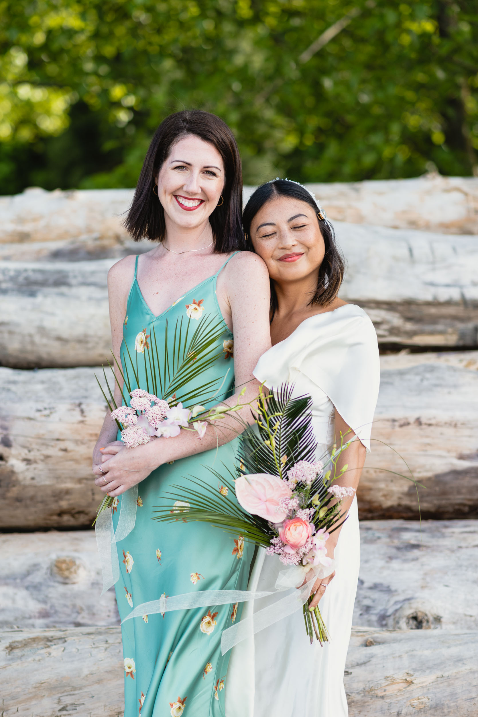 Bride and maid of honour at beach
