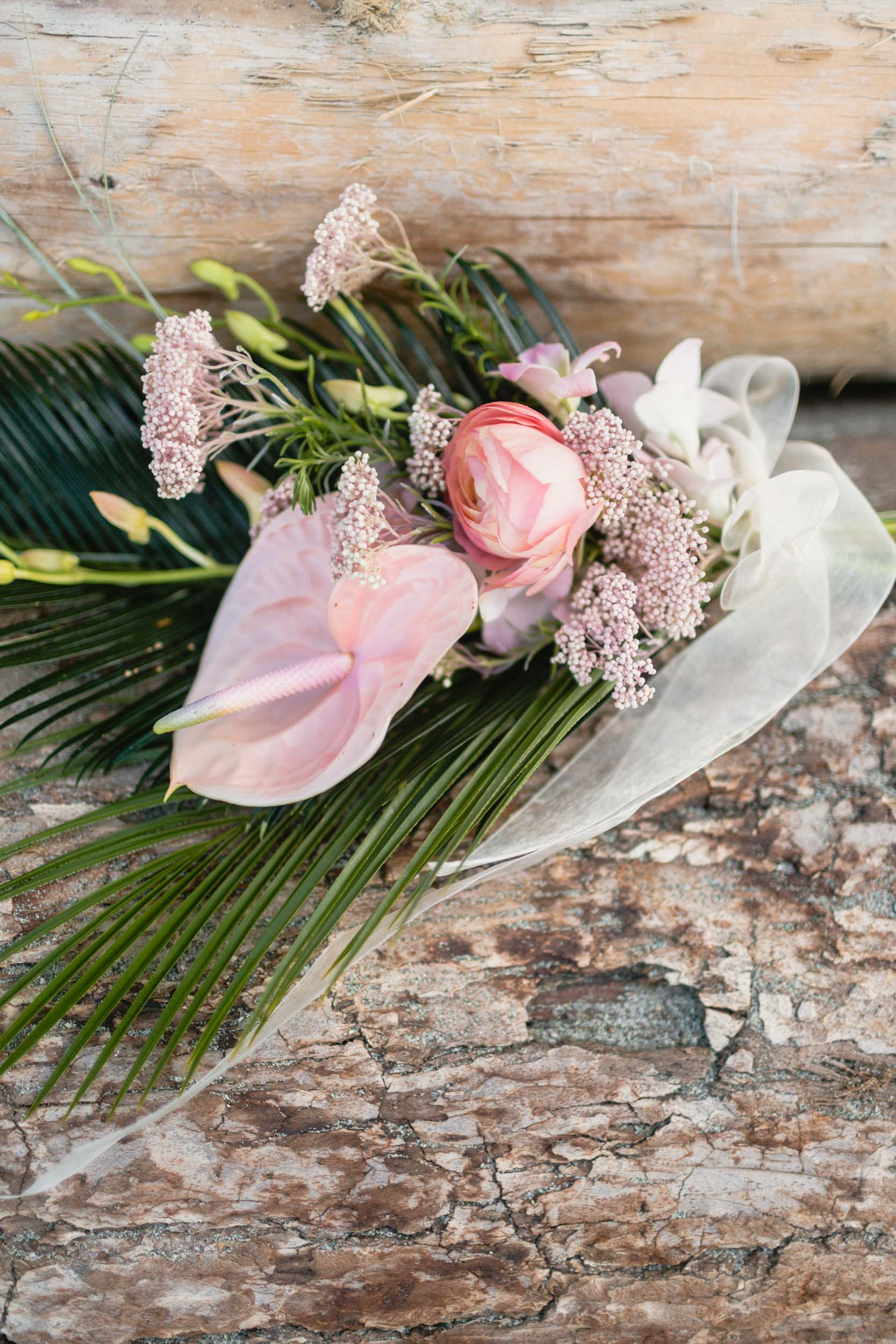 Bouquet resting on logs