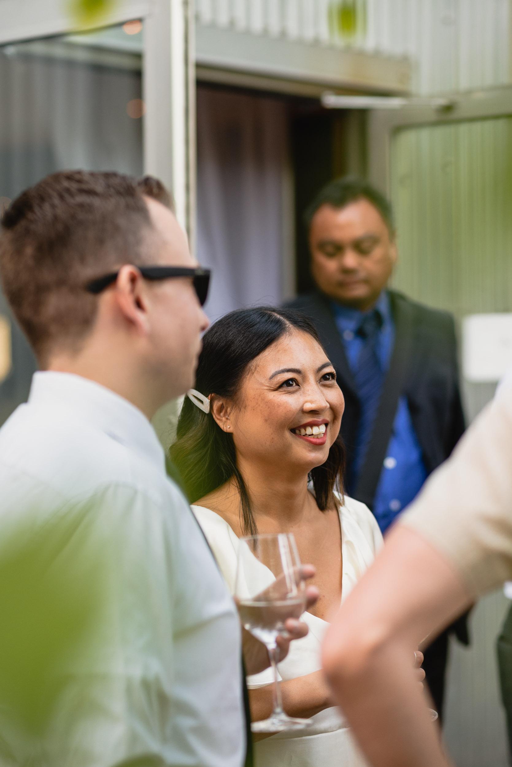 Bride smiles during reception