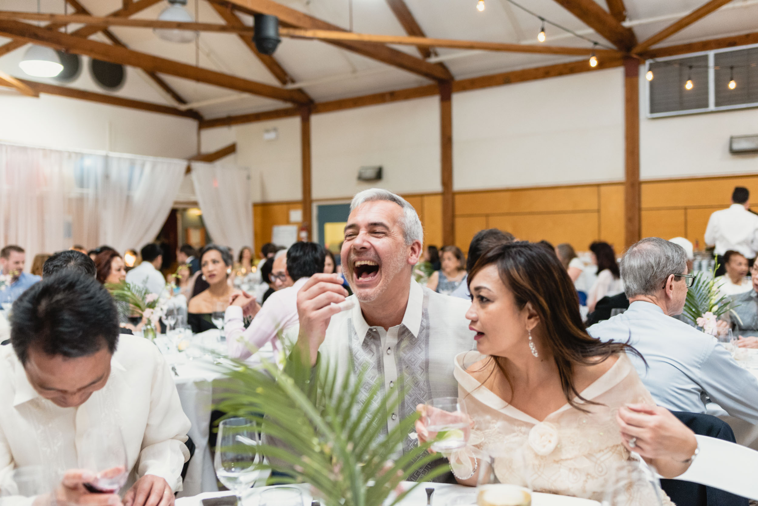 Guests laughing during dinner