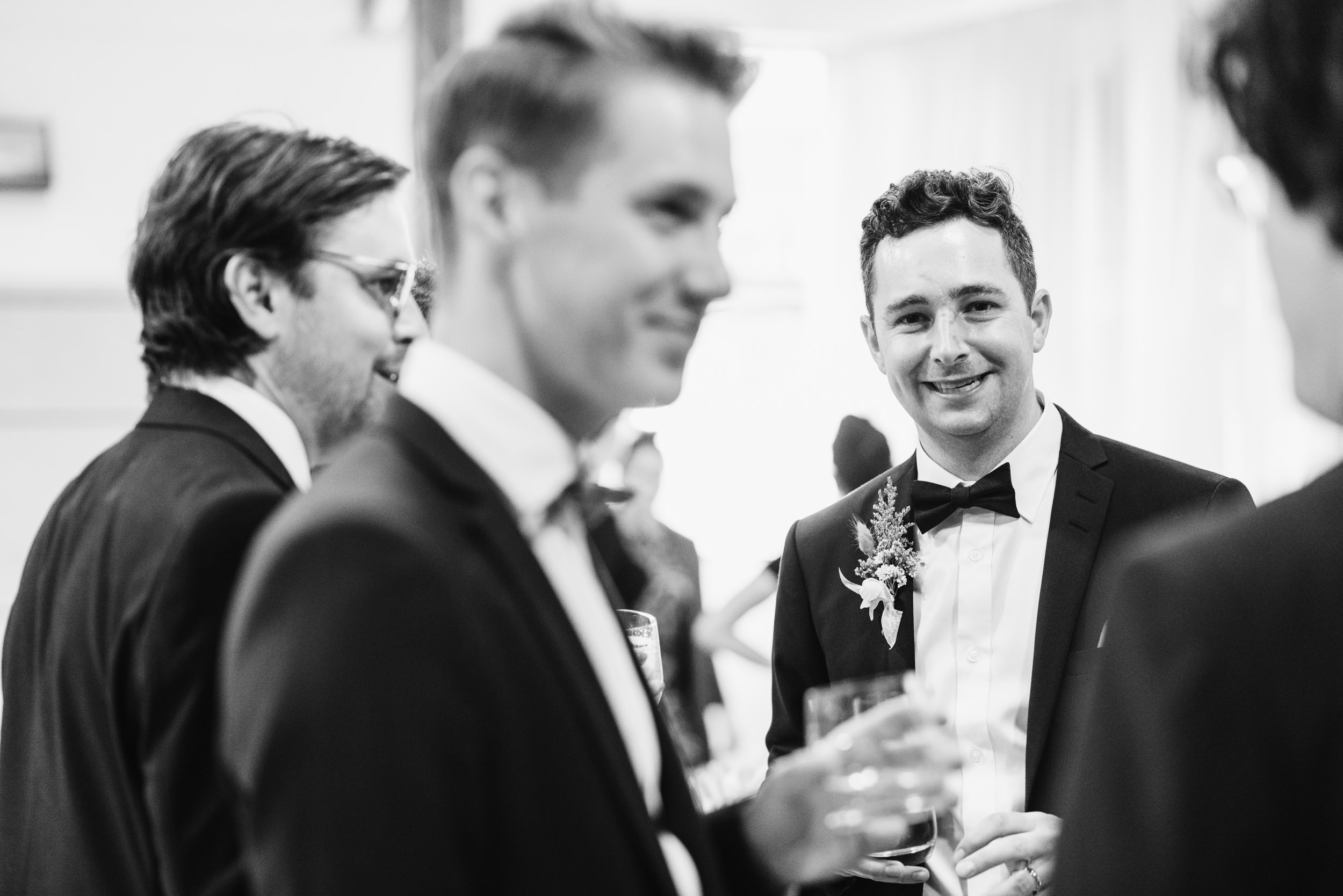 Groom socializing during reception