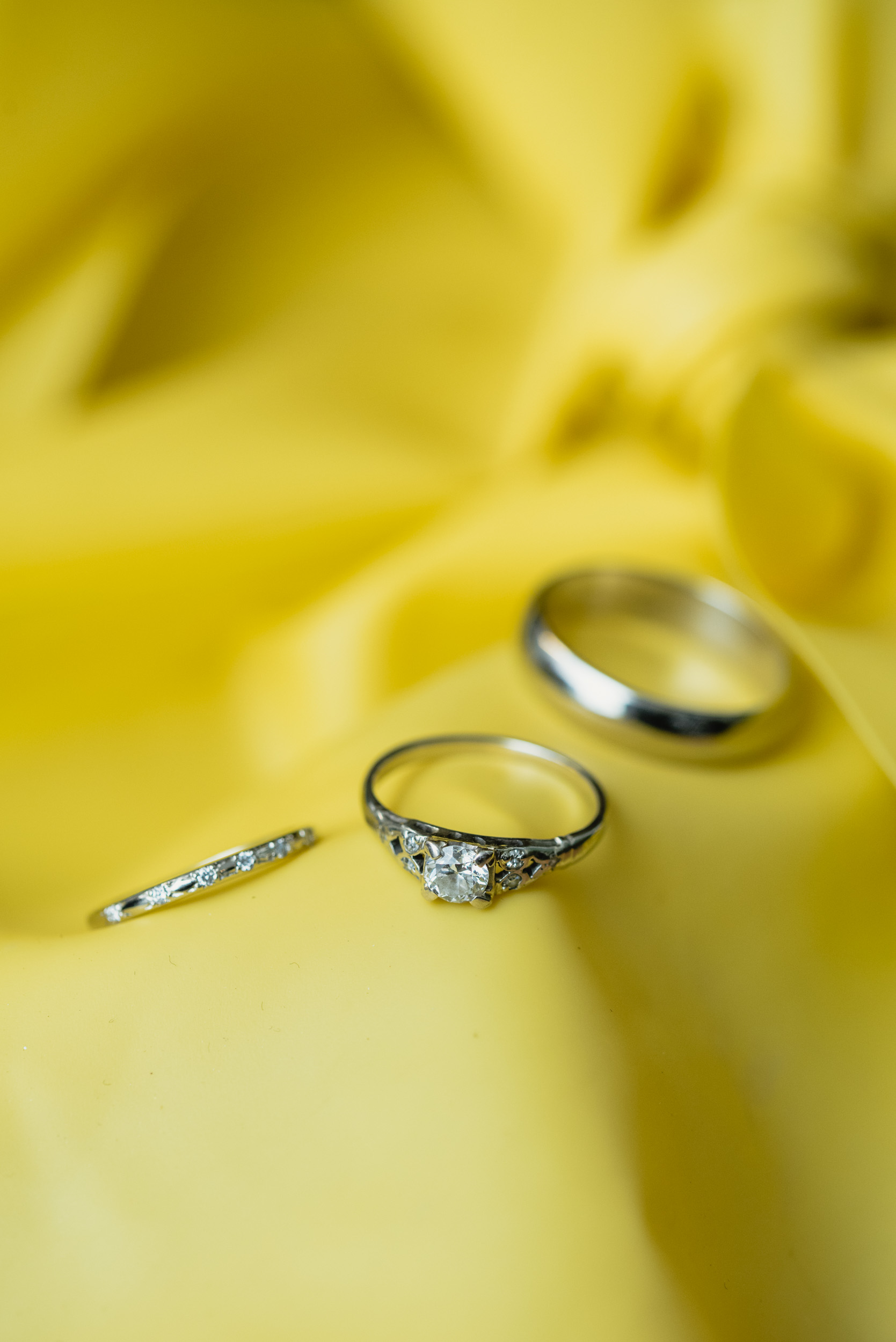 Wedding rings on yellow background