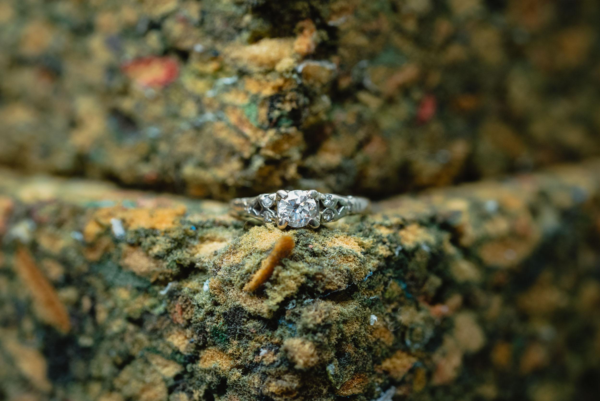 Wedding ring on textured background