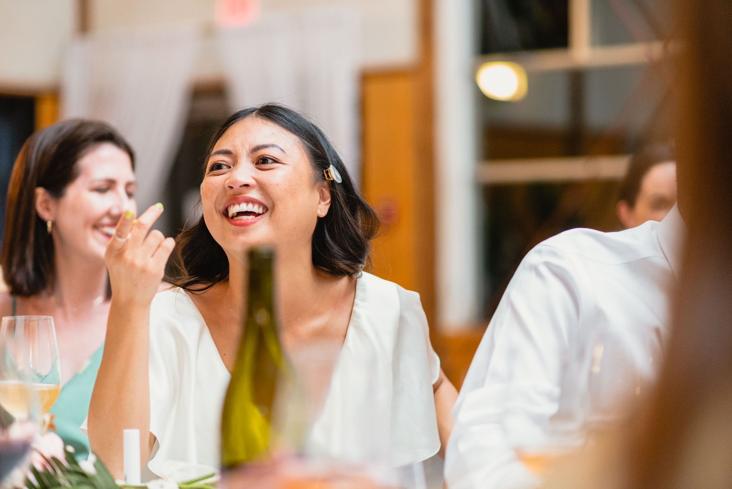 Bride laughs during dinner
