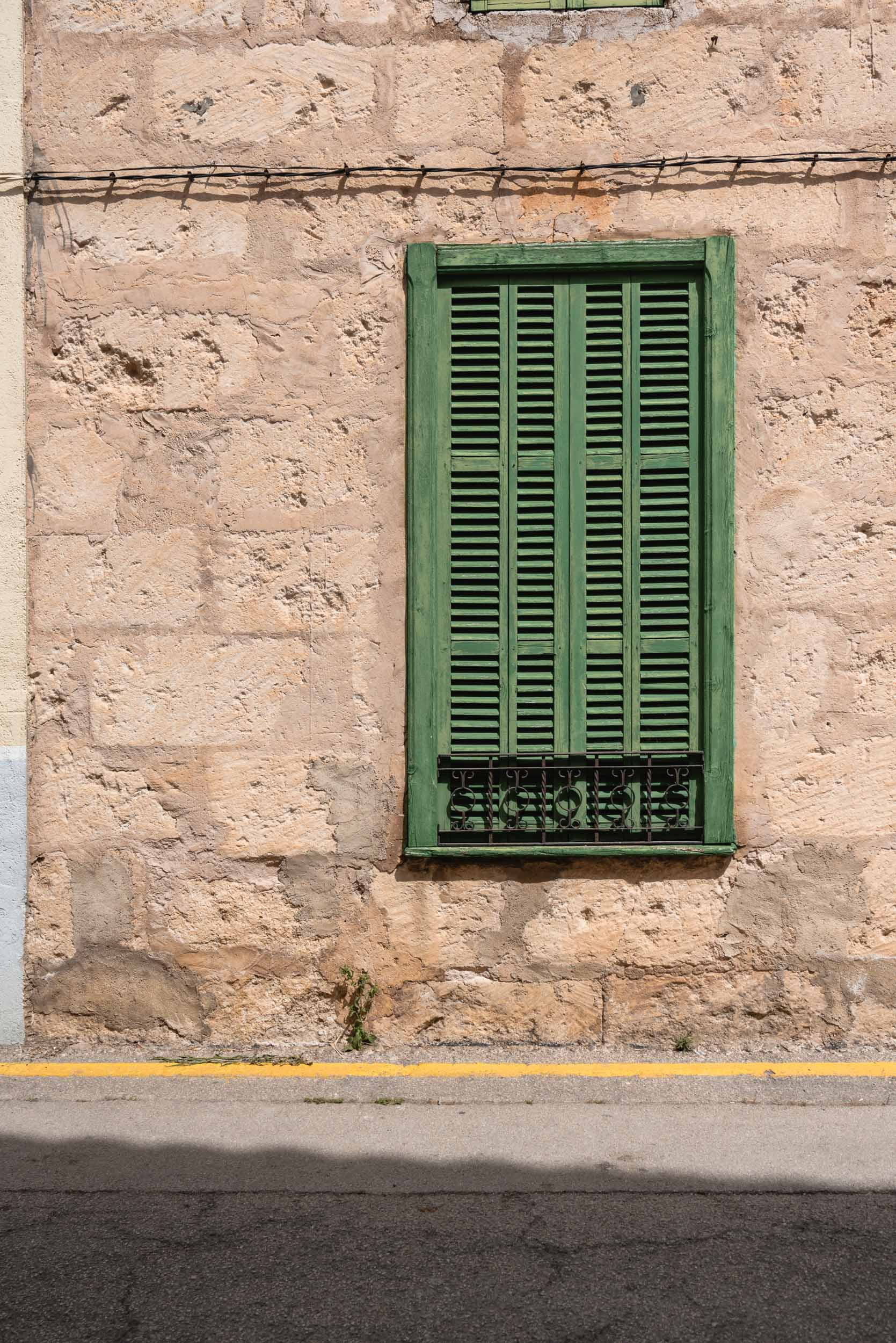 Green window in Sineu, Spain
