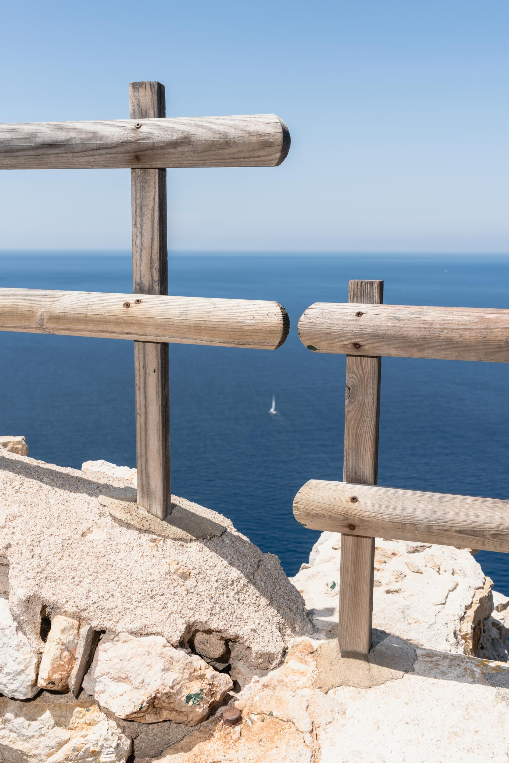 Ocean through railing Cap Formentor