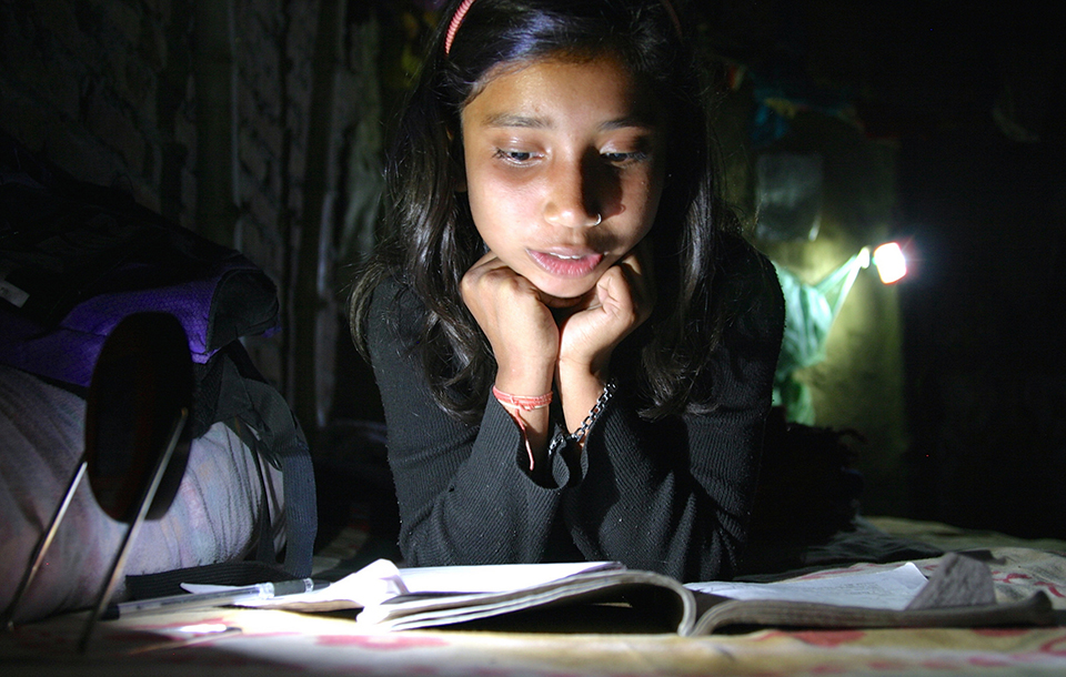 THIS LITTLE LIGHT OF HERS IS SOLD BY WOMEN ENTREPRENEURS IN REMOTE VILLAGES IN NEPAL. MENTORS WITH SCU'S MILLER CENTER HELPED THE SOCIAL ENTERPRISE THAT STARTED THE PROGRAM, EMPOWER GENERATION. PHOTOGRAPHY COURTESY EMPOWER GENERATION.