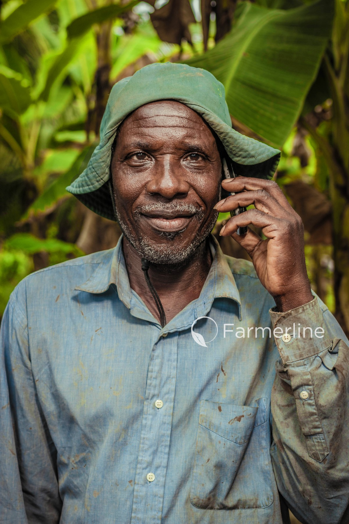 FARMERLINE CUSTOMER RECEIVING TROPICAL WEATHER FORECAST VIA VOICE IN HIS LOCAL LANGUAGE, COURTESY OF FARMERLINE
