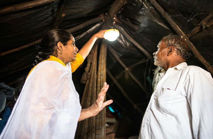 POLLINATE ENERGY TRAINS AND EMPOWERS LOCAL ENTREPRENEURS TO ESTABLISH SUSTAINABLE MICRO-BUSINESSES THAT PROVIDE CLEAN ENERGY SOLUTIONS TO INDIA'S URBAN SLUMS. PHOTO COURTESY OF POLLINATE ENERGY.