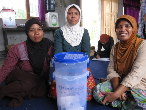 Beneficiaries and a Nazava water filter.