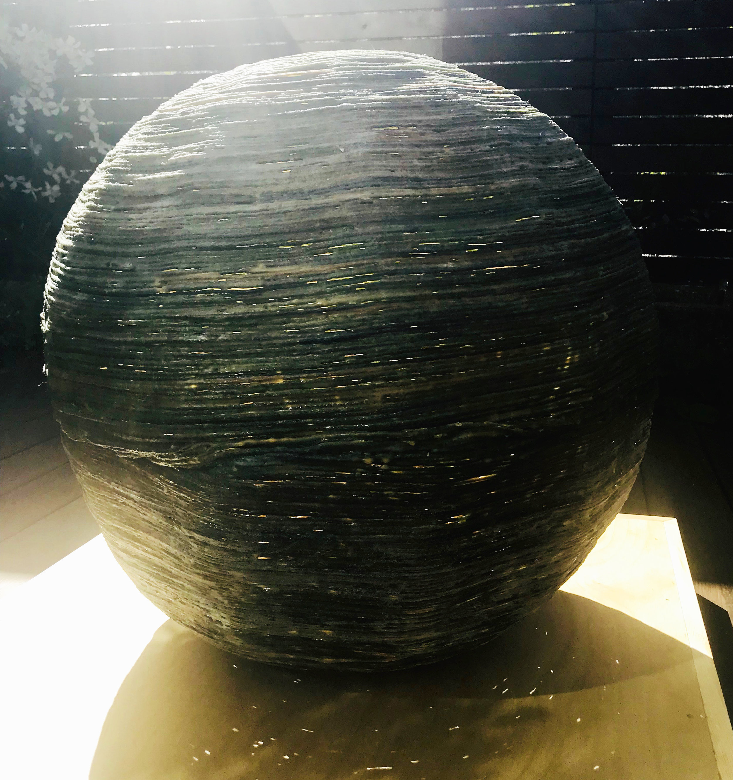 String/beeswax sphere melting in sun May 1, 2019.