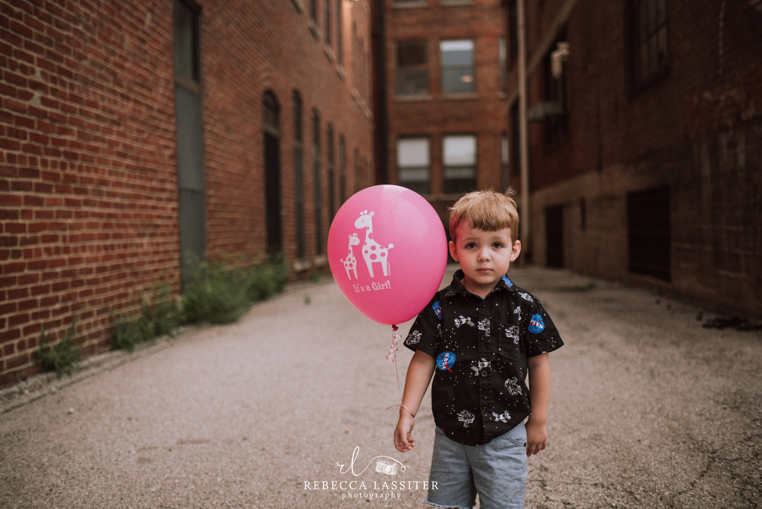 Birth Announcement - How cute and simple is this? This was about 2 seconds of pause before he was off on his own adventure. A very candid moment as he stood with this balloon. About as posed as a two year old gets.