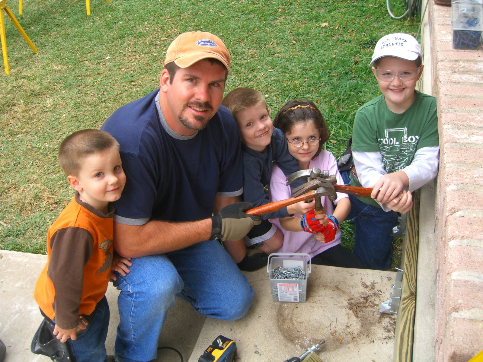 Alan and kids with hammers.jpg