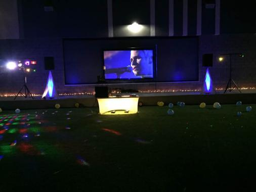 setup for a middle school dance with 12' video screen and projector