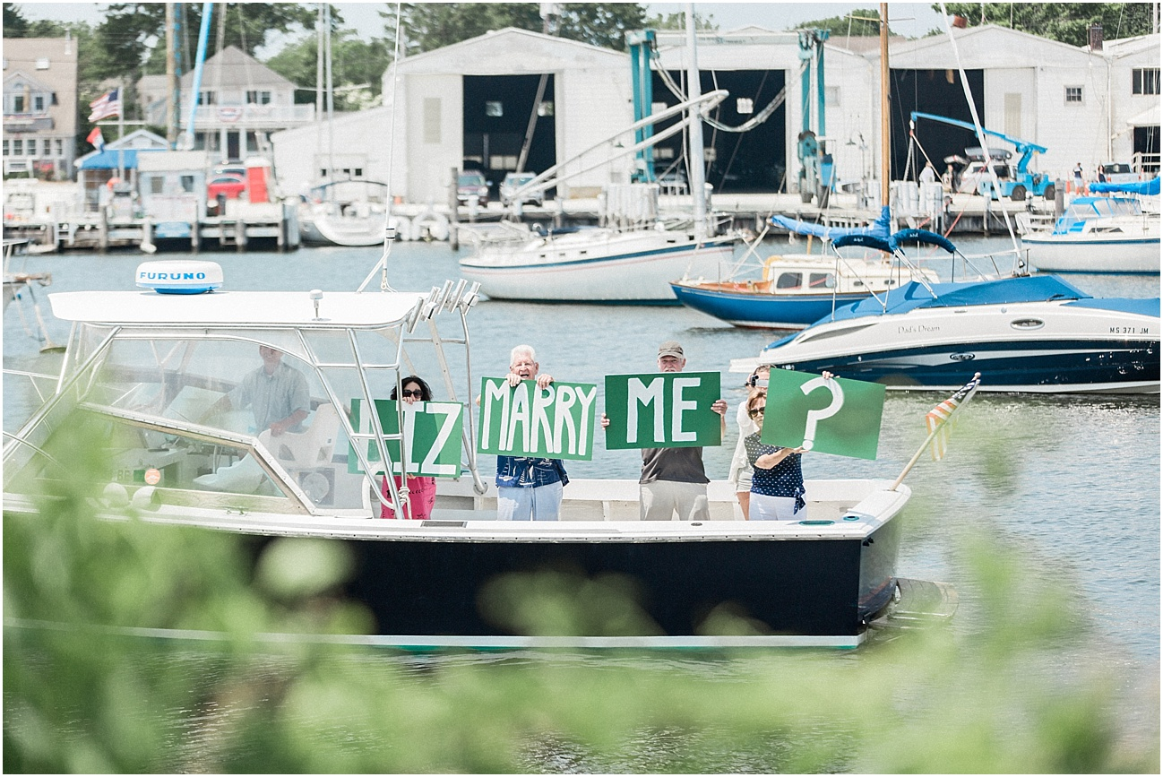 falmouth_liz_eric_proposal_boat_parents_sign_will_you_marry_me_cape_cod_boston_wedding_photographer_meredith_jane_photography_photo_0510.jpg