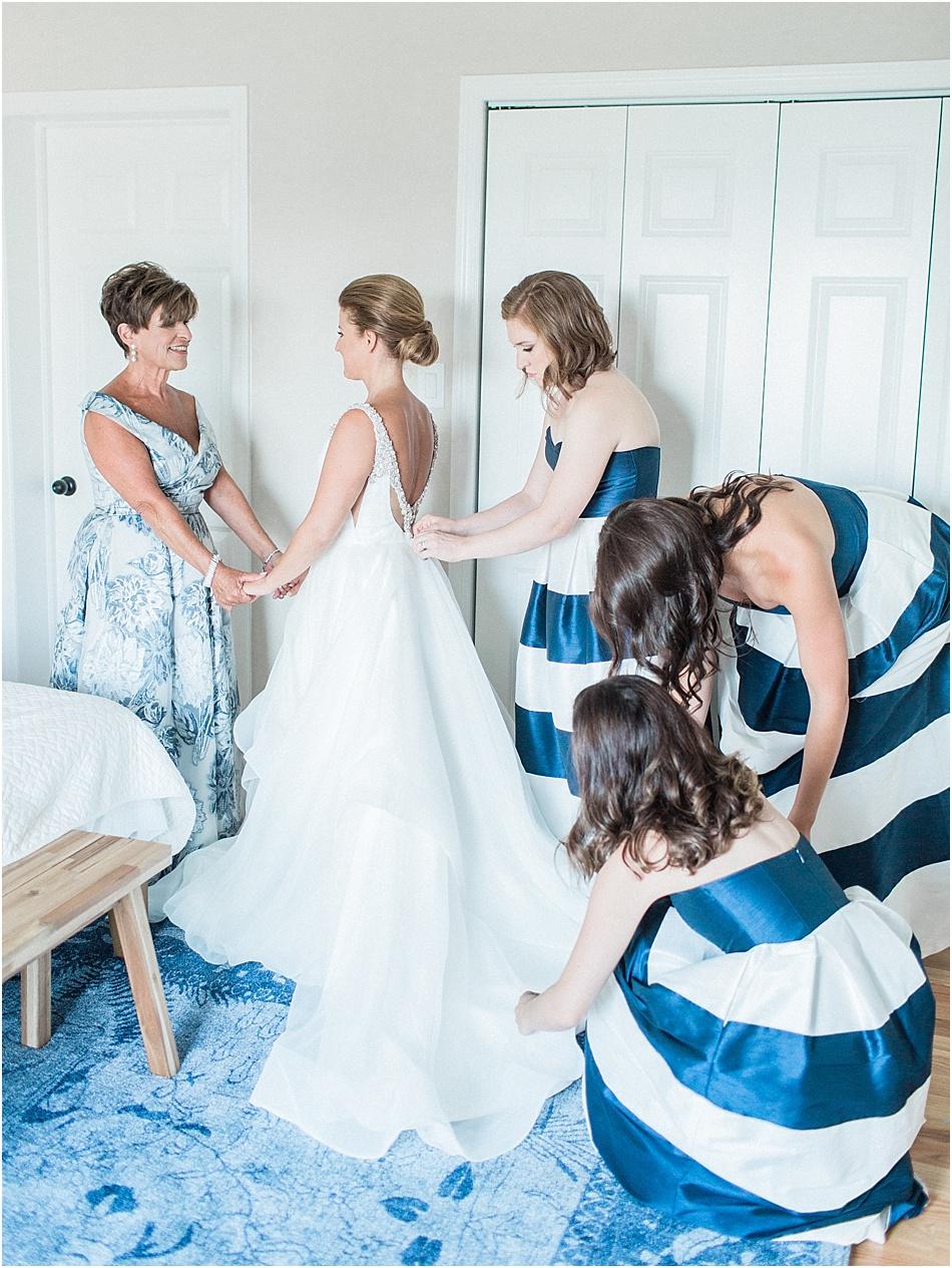 kyndra_matt_newport_beach_house_rhode_island_striped_bridesmaids_dresses_cape_cod_boston_wedding_photographer_Meredith_Jane_Photography_photo_0188.jpg