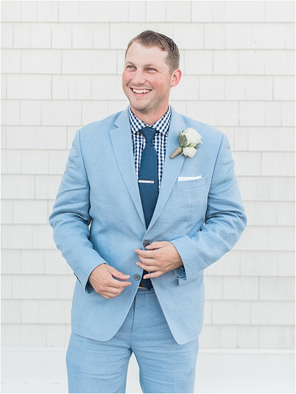 kyndra_matt_newport_beach_house_rhode_island_striped_bridesmaids_dresses_cape_cod_boston_wedding_photographer_Meredith_Jane_Photography_photo_0199.jpg