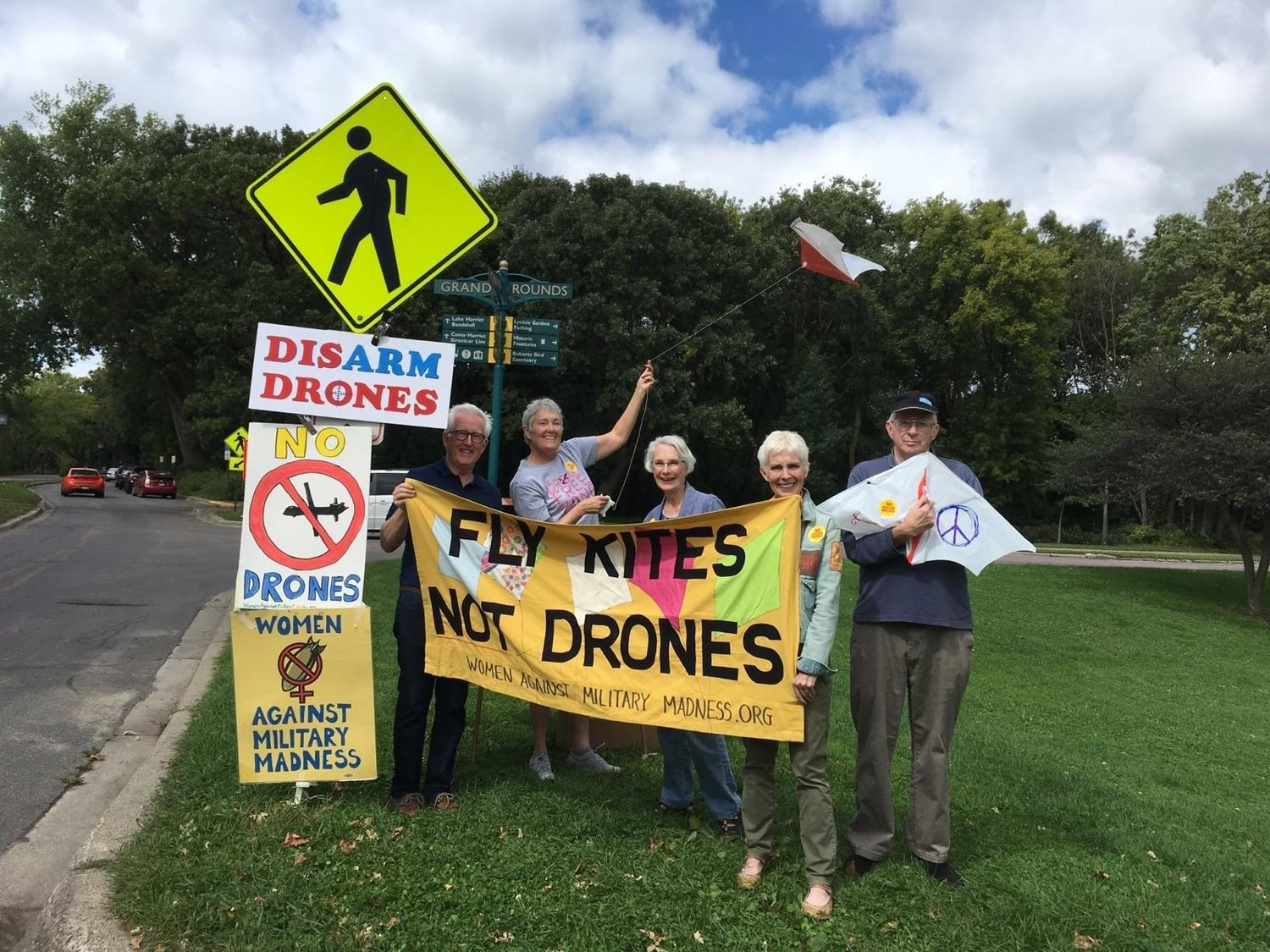 Several members of the Ground All Drones committee participating in their most popular and well known action, flying kites not drones!