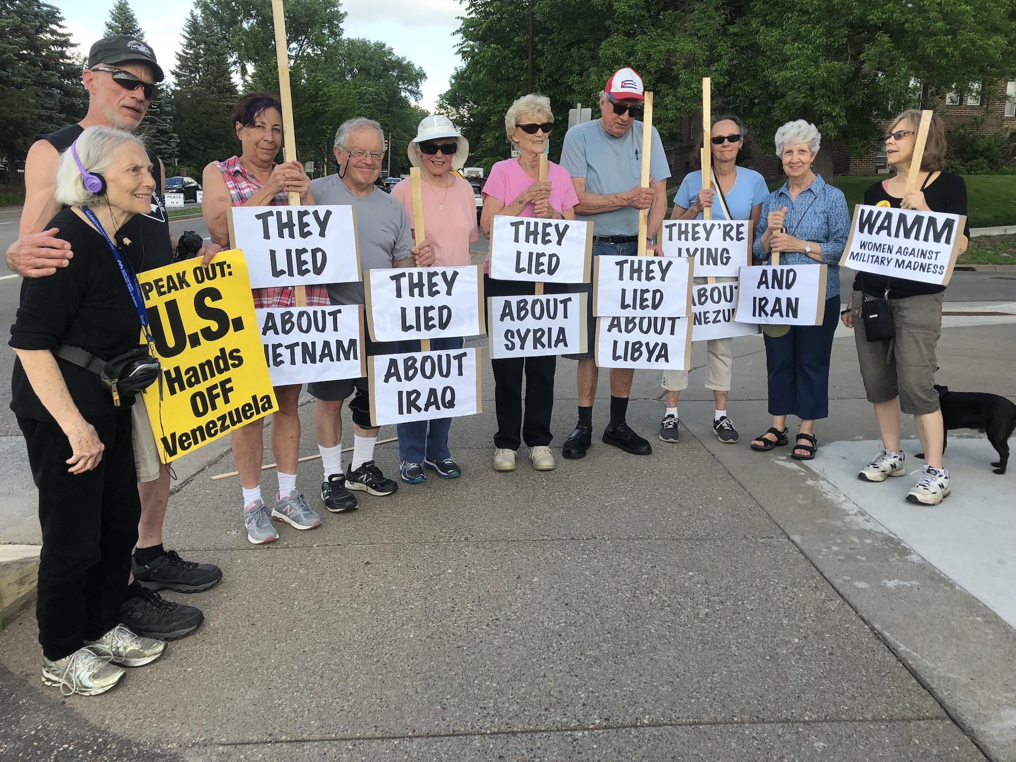 They Lied signs Wednesday Bridge Vigil