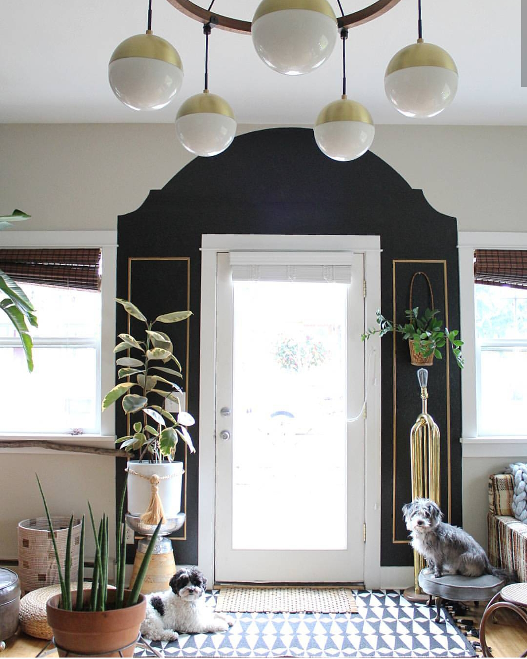 Painting around the exterior of the door created an interesting focal point and made the entrance feel larger.