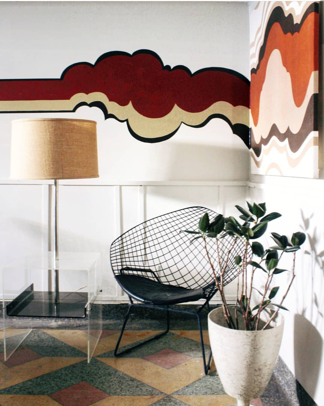 This wall painting was inspired by the art hanging to the right and extended on to the wall.