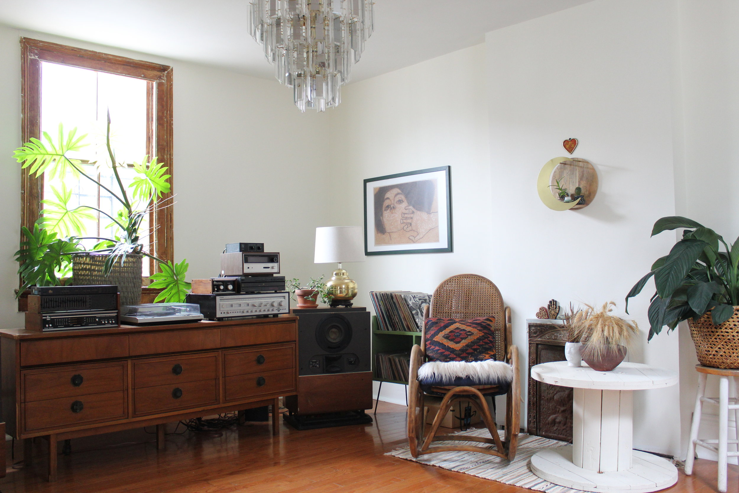 First impression to the home. Original chandelier and a collection of vintage thrifted items.