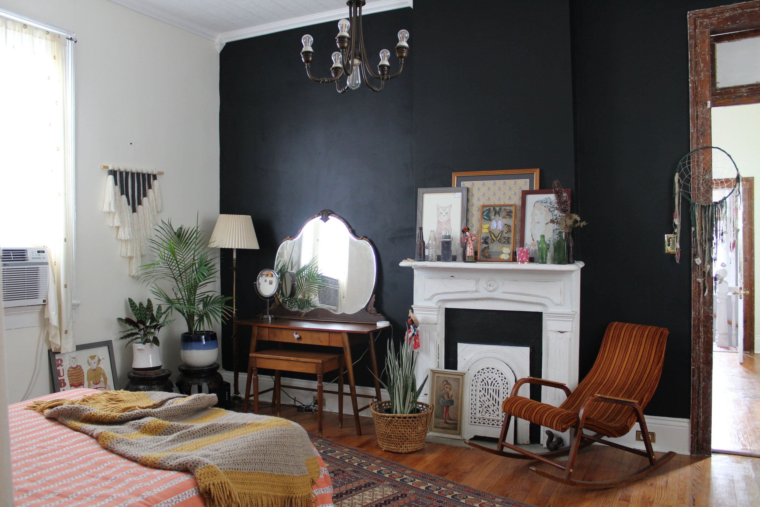 Bold black accent wall to add drama in the space.