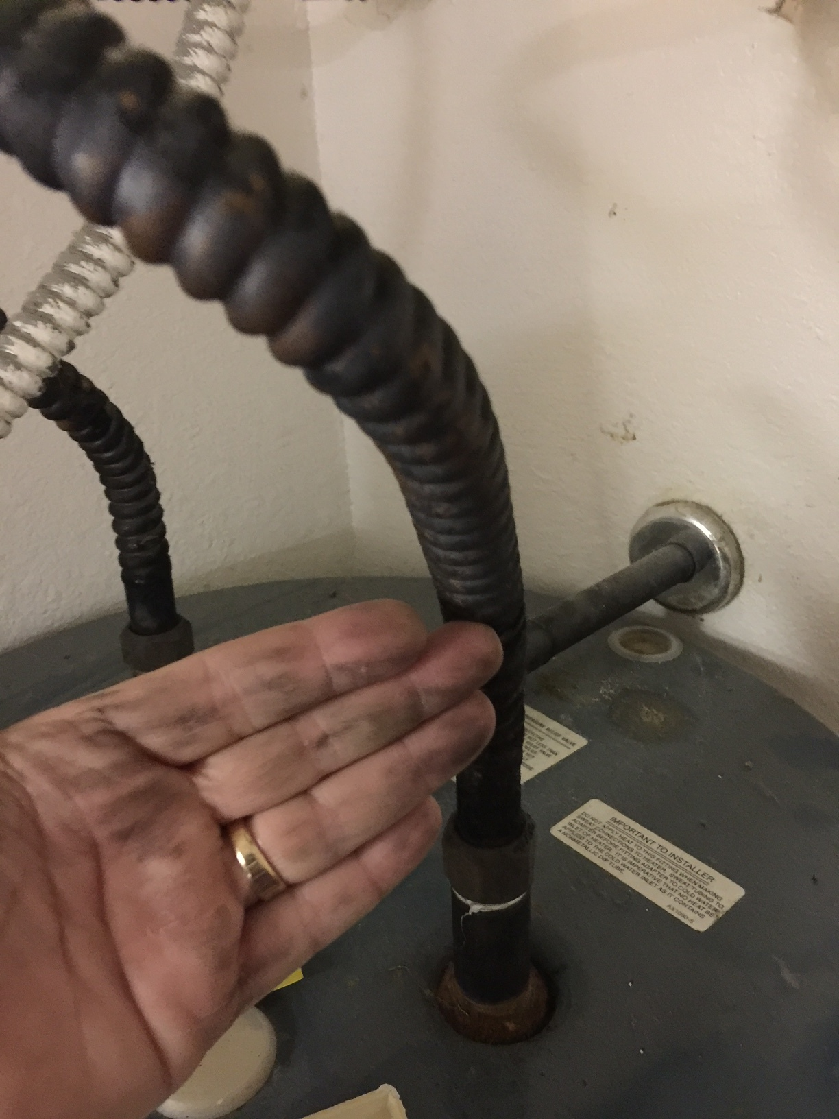 Black Rubbed Off on Hand, Hot Water Heater Copper Plumbing Line Due to Chinese Drywall Found During Home Inspection Houston Texas