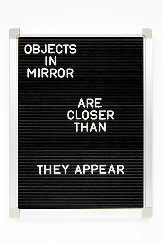 objects in mirror are closer than they appear copy.jpg