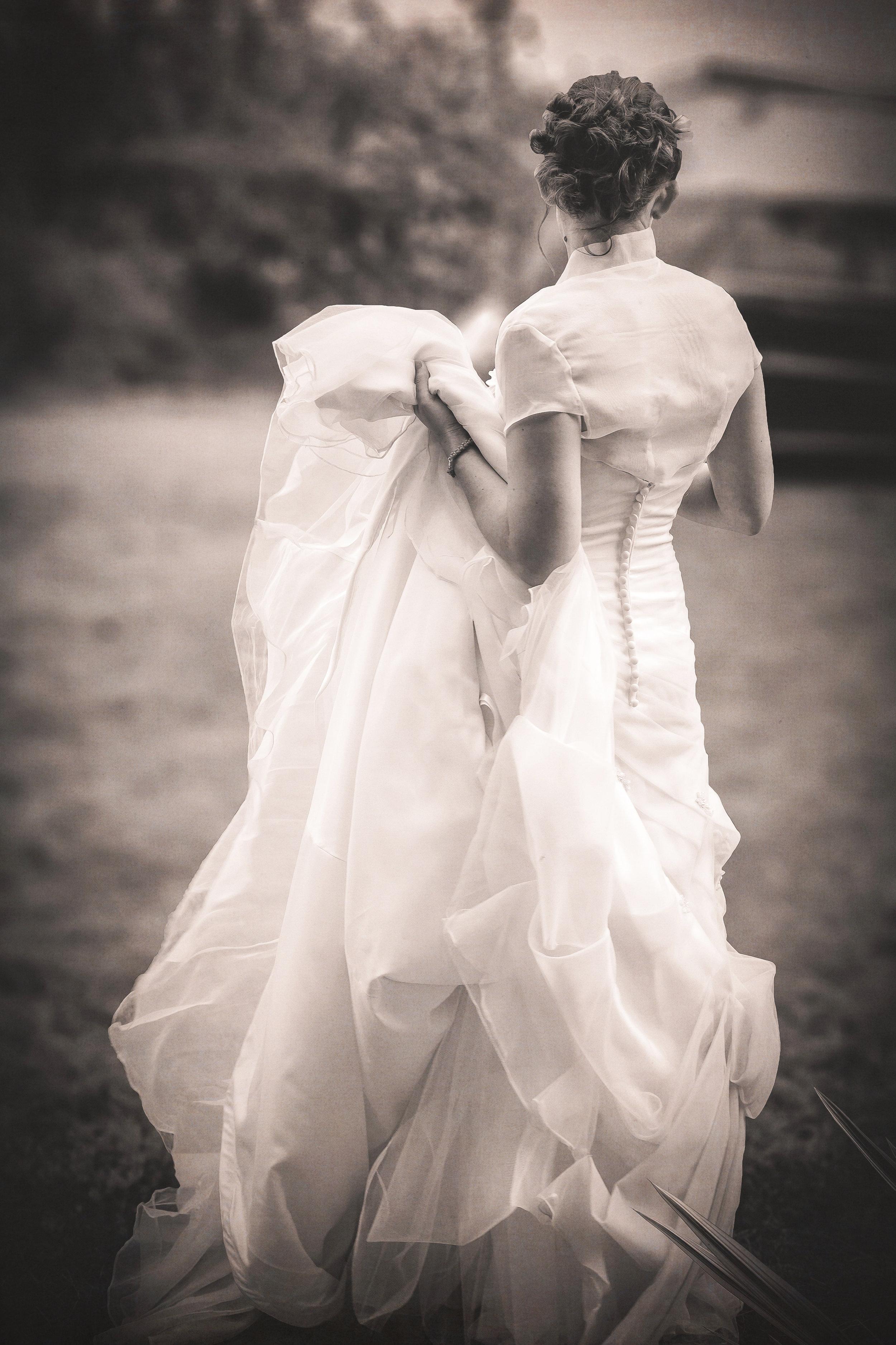 24. Bride awaits tractor.JPG