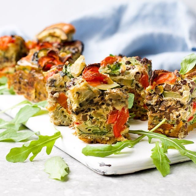 SUMMER veggie & lentil frittata bites anyone?🙋🏼‍♀️ Plenty of plant-based diversity in this one - always thinking about feeding those microbes 🦠 .... Gut-loving and picnic-perfect for #NationalPicnicWeek this week - one to save for any al fresco dining this summer!☀️ Enjoying more time out doors amongst nature is also linked with better gut health. .... I used the veggies below, but you can swap for any of your favourites or leftover vege begging to be used up. Just make sure there's some variety 👍 .... INGREDIENTS 🍠 1 sweet potato, finely sliced 🥕 1 large carrot, finely sliced 🥒 1 courgette (zucchini), finely sliced 🍆 1 aubergine (eggplant), finely sliced into moons 🌶 1 red pepper (capsicum), chopped into small cubes 🌿 handful of rocket  200g tinned lentils, rinsed and drained  1 onion, finely sliced 1 garlic clove, crushed 🥚12 eggs (I use free-range) 🧂1/2 tsp salt & black pepper .... METHOD  1️⃣ Pre-heat the oven to 180deg and line a 20x20 baking dish with baking paper 2️⃣ Roast the sliced veggies in the oven for around 25-30 mins, until they're a little crispy  3️⃣ Whisk the eggs with salt and black pepper  4️⃣ Heat a small frying pan with a little extra virgin olive oil and gently soften the onion for 5 mins, stirring occasionally  5️⃣ Add the garlic and cook for a further 2 mins, then add the eggs and stir through  6️⃣ Arrange a layer of sweet potato and carrot round slices on the base of the lined baking dish 7️⃣ Add half of the rocket, half of the lentils and pour half of the egg mix over 8️⃣ Arrange a layer of courgette and aubergine slices, add the red pepper followed by the rest of the rocket, lentils and then egg mix, before layering with a final topping of any remaining roasted veggies  9️⃣ Place in the oven and cook for 50 mins, then allow to cool before serving 🔟 Cut into squares and enjoy - or pop into your picnic basket for a little later 🧺