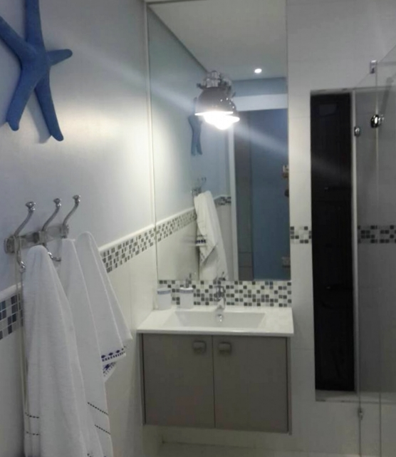 A simple bathroom for a young man in Zimbali.By not tiling from floor to ceiling you save money on tiles and labour!