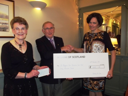 Eilean presenting one of her many cheques to Margaret Kerr Unit in 2015