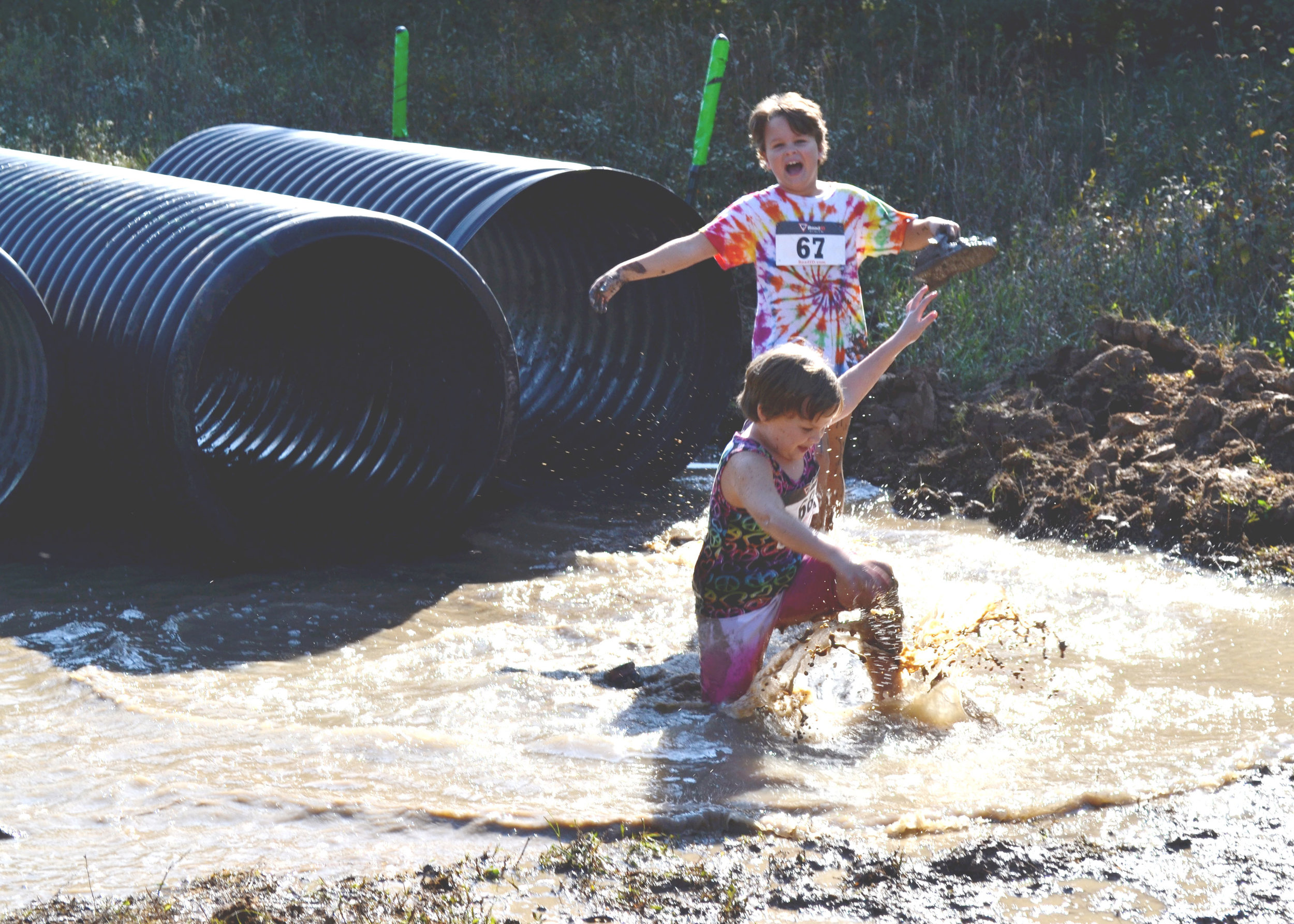 Two-Kids-Splashing-Tube-Obstacle.jpg