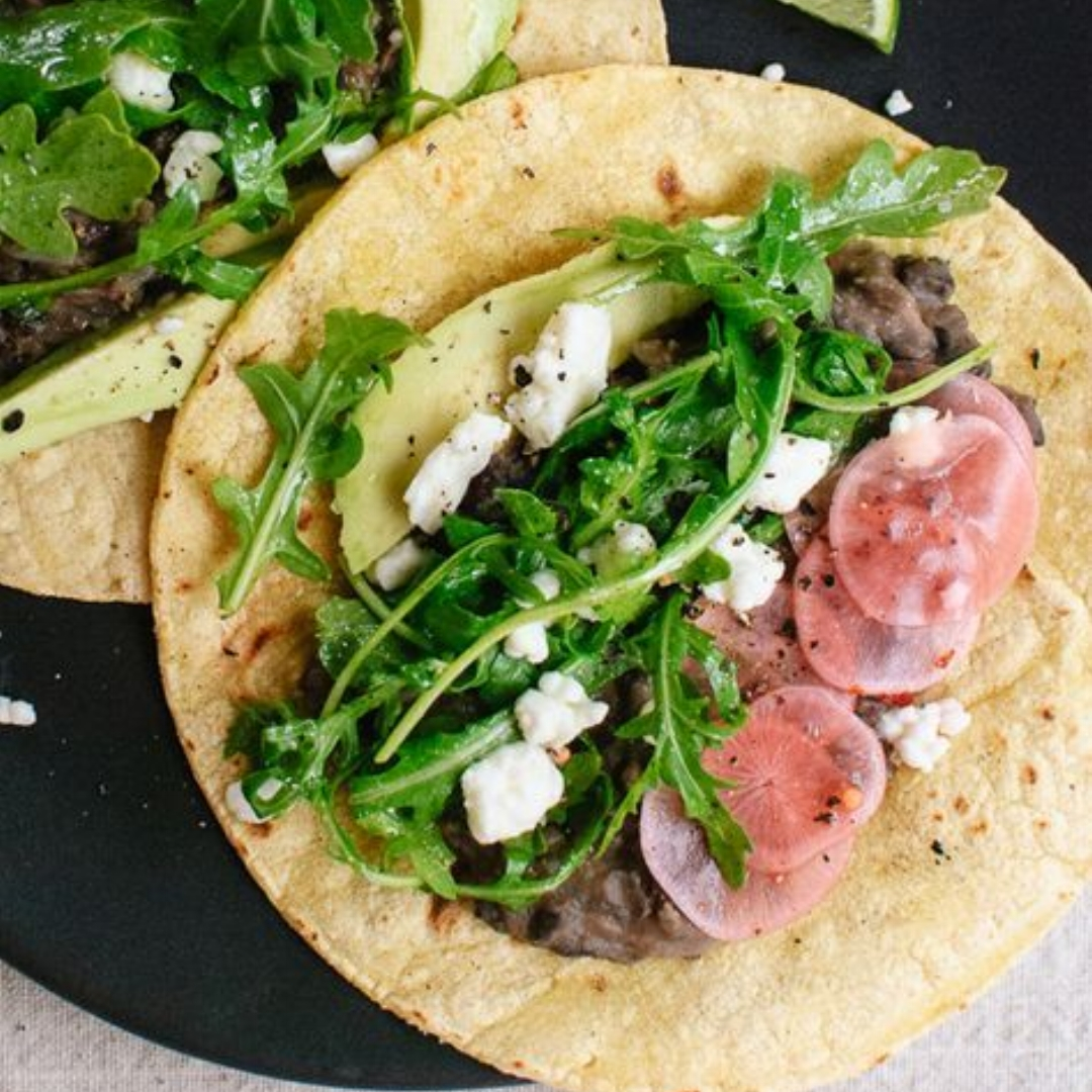 1.Vegetarian Arugula and Black Bean Tacos with Pickled Radish and Feta - by Cookie and Kate