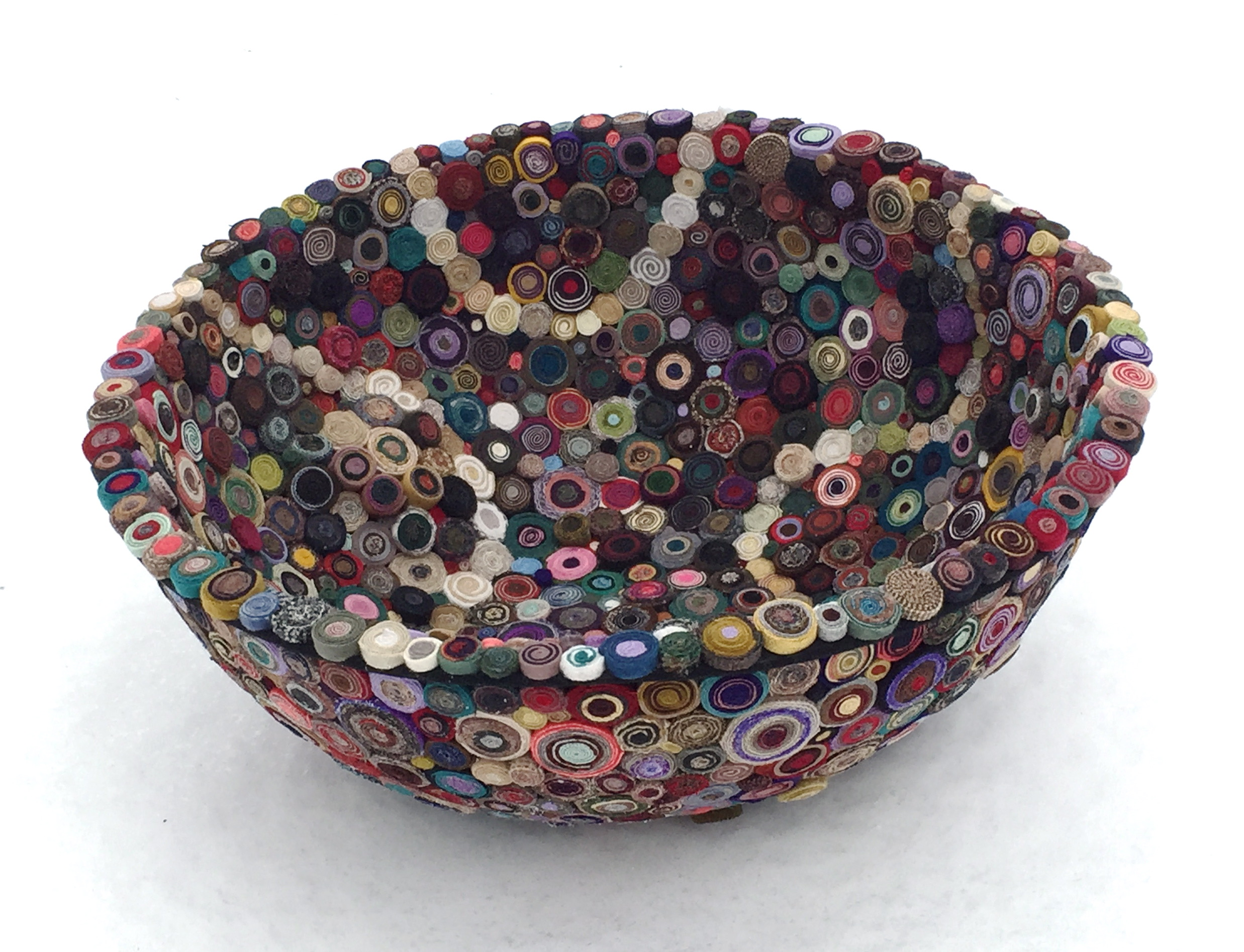 """Tossed   2016 8"""" height x 69"""" circumference  Hand cut and coiled wool strips fixed to found stainless steel mixing bowl. (1475 coils)"""