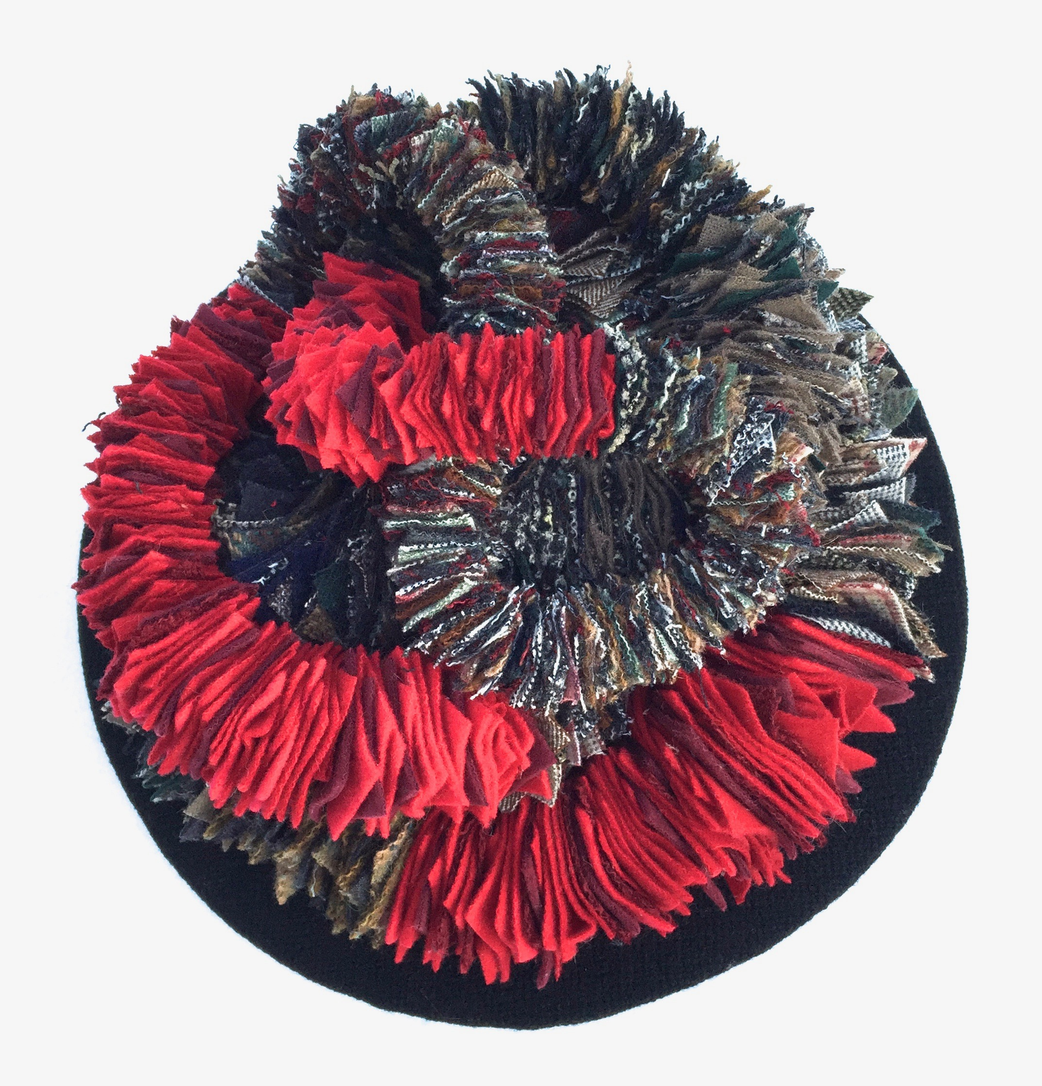 """It Is What It Is  2016 8.5"""" height x 12.5"""" diameter. Wool and wool blend woven fabric, hand cut and sewn, set on wool covered disc.A rrangement variable."""