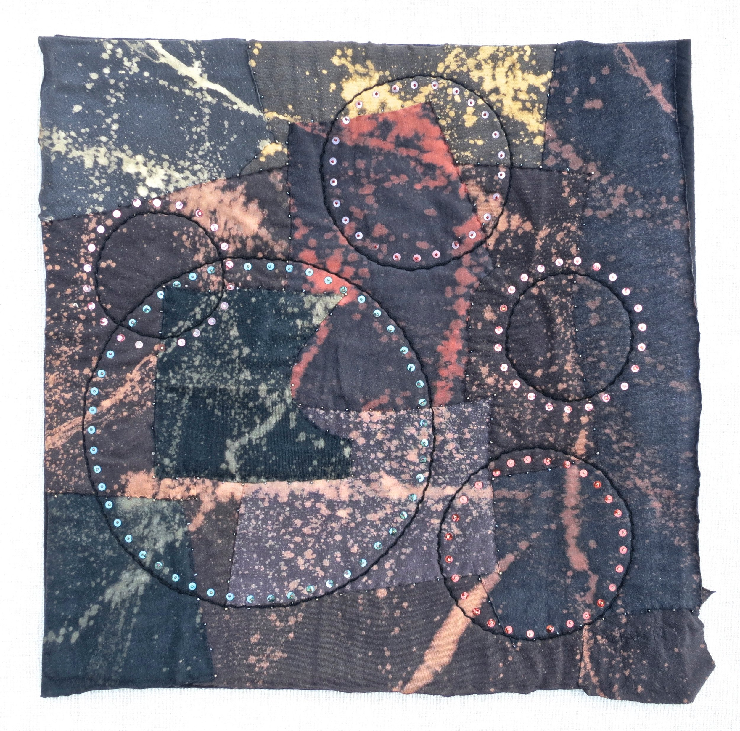 """Black T Boro: Splat and Spin   2014 20.5"""" x 20.5"""" Repurposed cotton t-shirts appliqué, rayon thread embroidery with vintage sequins and glass beads."""