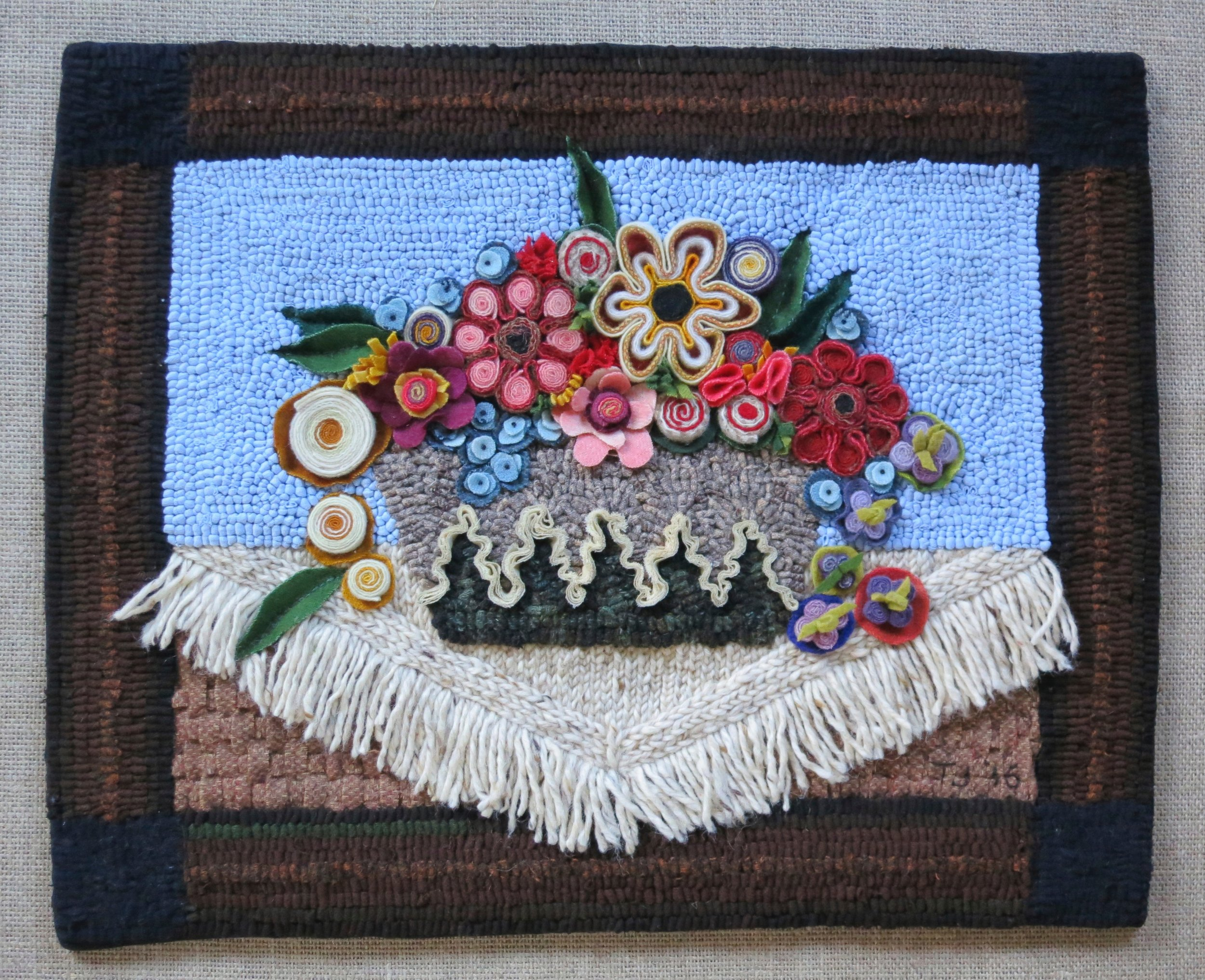 """Frank's Flower Pot   2016 16"""" x 20"""" Wool coiled, standing wool, chain stitched, b ias shirred, woven, bundle shirred, fringed and appliqued;   cotton knit hand hooked.    Frank's Flower Pot finished,pattern available in Shop Section."""