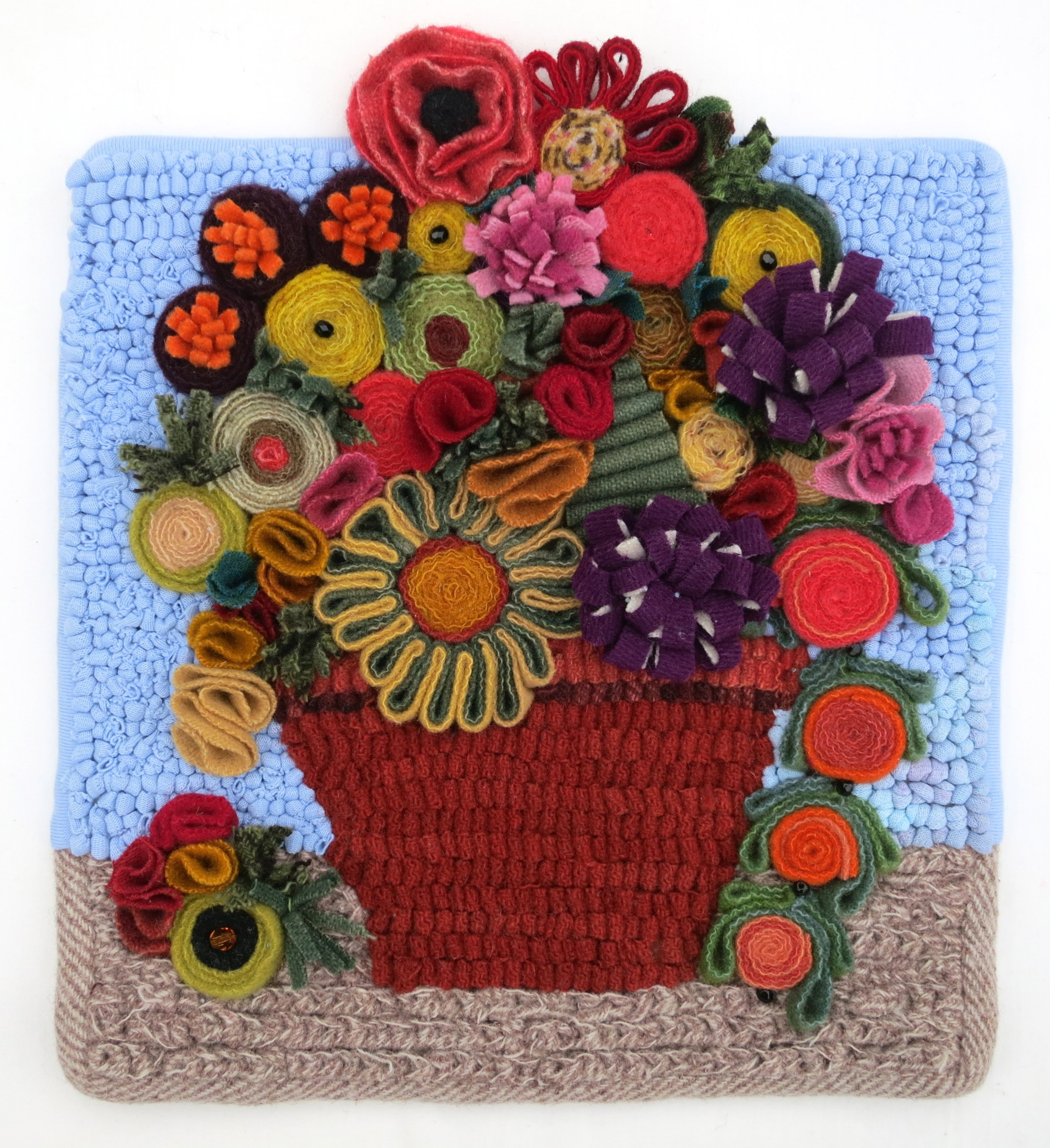 """An Abundance    Flower Pot 2015 9.5"""" x 8"""" Wool, cotton knit and glass beads hand sewn,hand hooked,standing wool, coiled, shirred (pleated, fringed, bundled) and chain stitched."""
