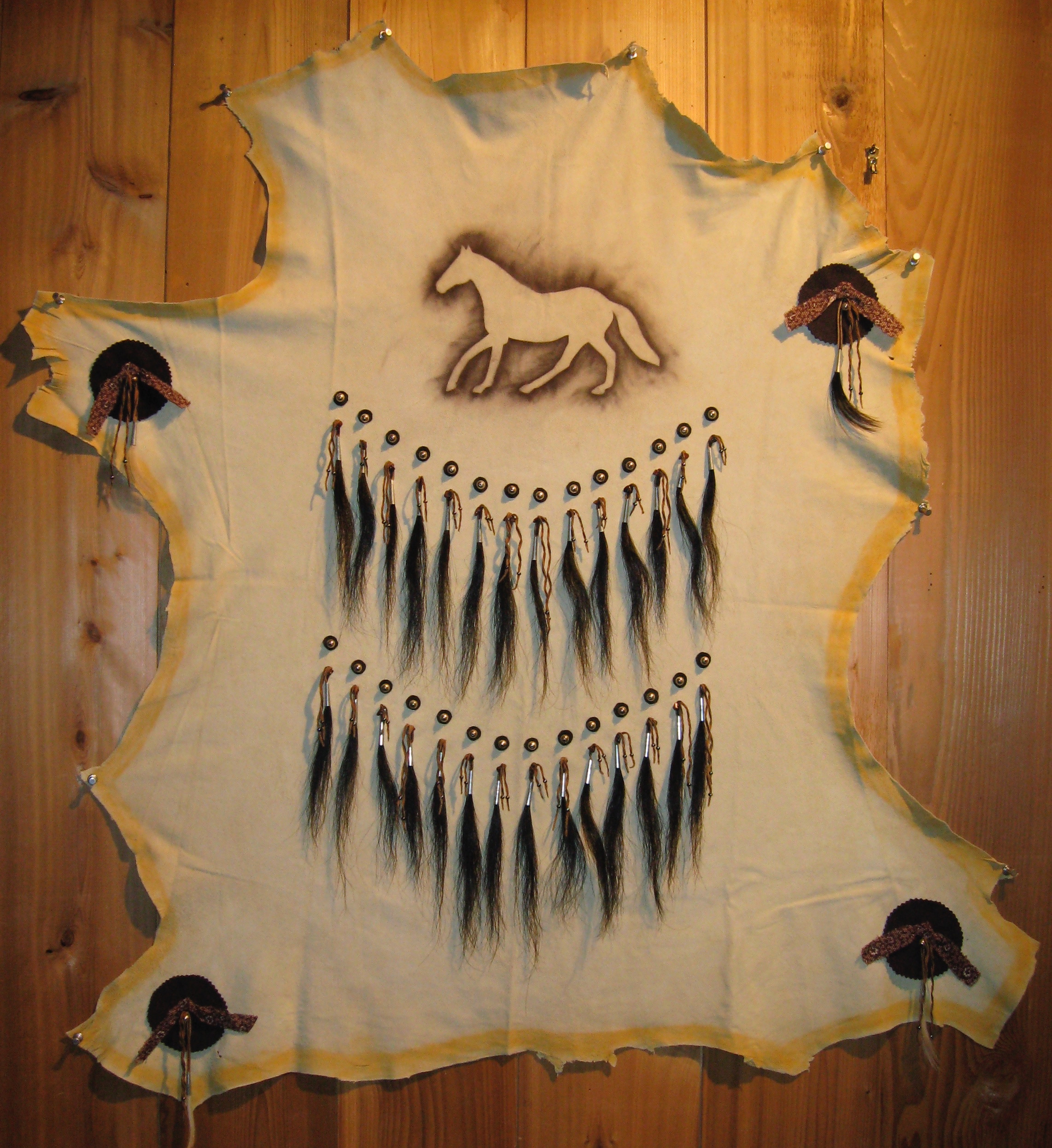 """My Mane Man   2008 41"""" x 38"""" Leather hide, horsehair, tin, cotton scraps and powdered pigment. A tribute to Fifty/50."""
