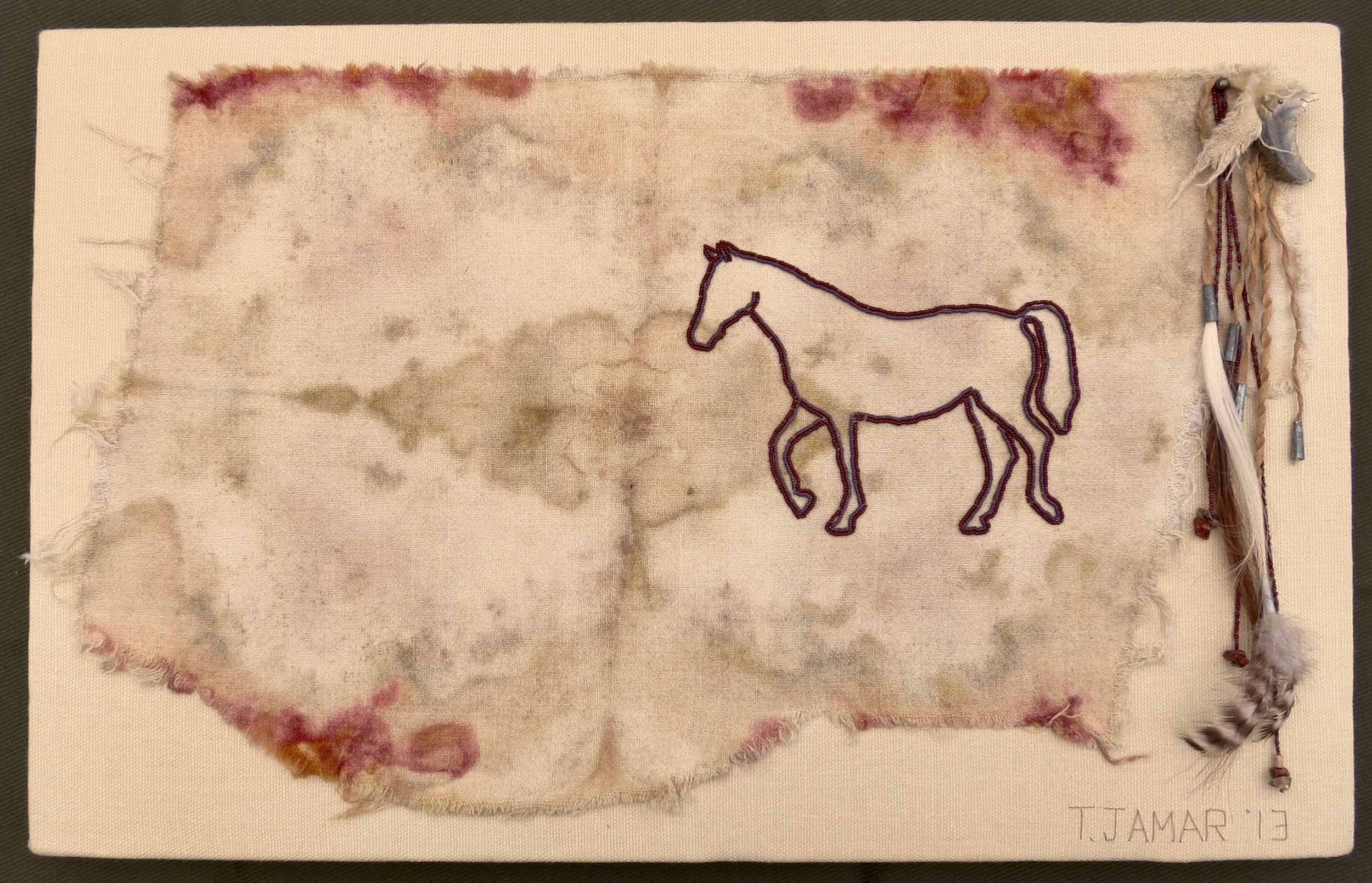 """Beadedglyph: Arrow    2013 14"""" x 22"""" Damaged wool, linen, tin, glass beads, horsehair, hoof, feather and leather hand sewn."""