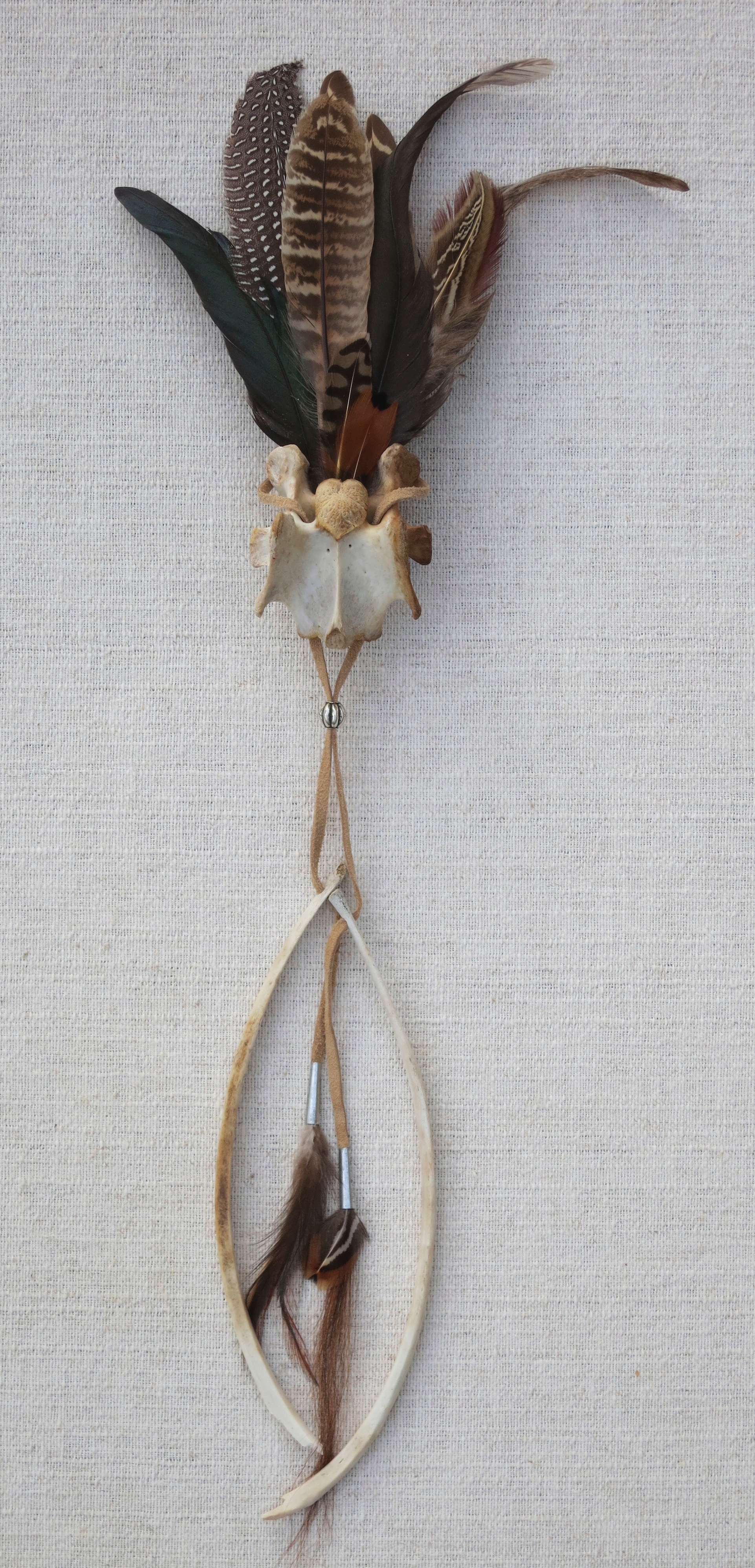 """Tribute #9   2014 21"""" Found feathers, deer bones assembled with leather, tin and horsehair."""