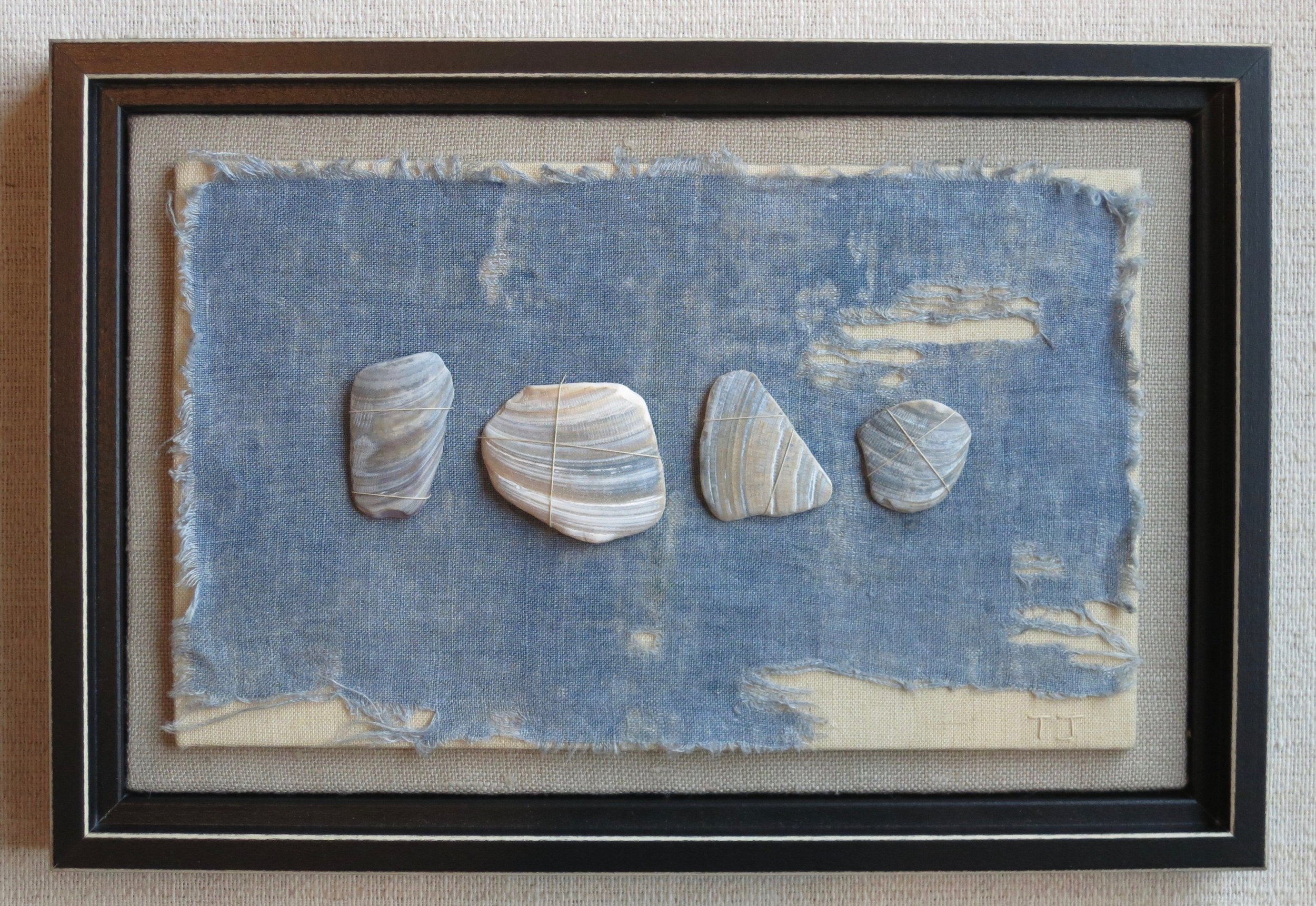 """Shell shards   2014 8.5"""" x 12.5"""" Shards hand sewn on faded blue fabric mounted on linen."""
